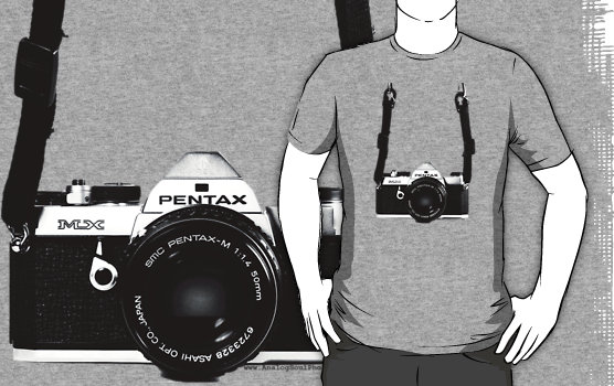 a Pentax film SLR camera dangling from a man's chest