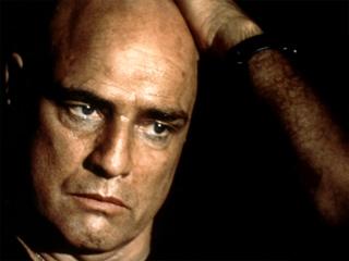 Marlon Brando as Kurtz in    Apocolypse   Now   ,  the   1979 film version of  Heart of Darkness .