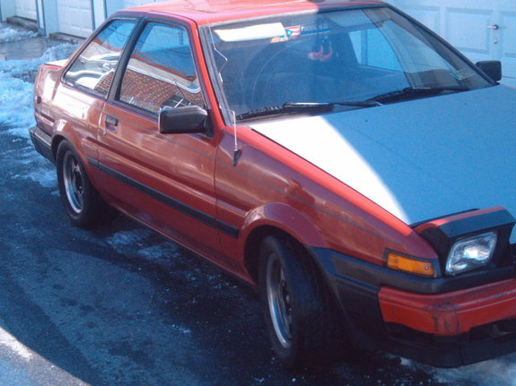 a copper-colored 1984 Toyota Corolla SR-5, like Paul's