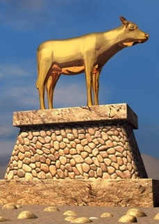 a statue of a golden calf standing on a stone pedestal