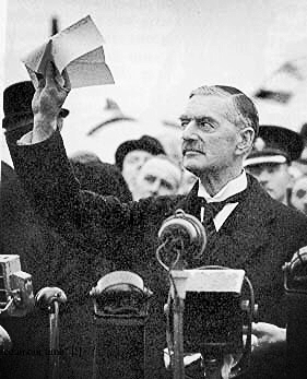 "The famous photo from the Munich Conference 1938 is that of Neville Chamberlain holding up a scrap of paper and claiming to have secured ""peace in our time""."