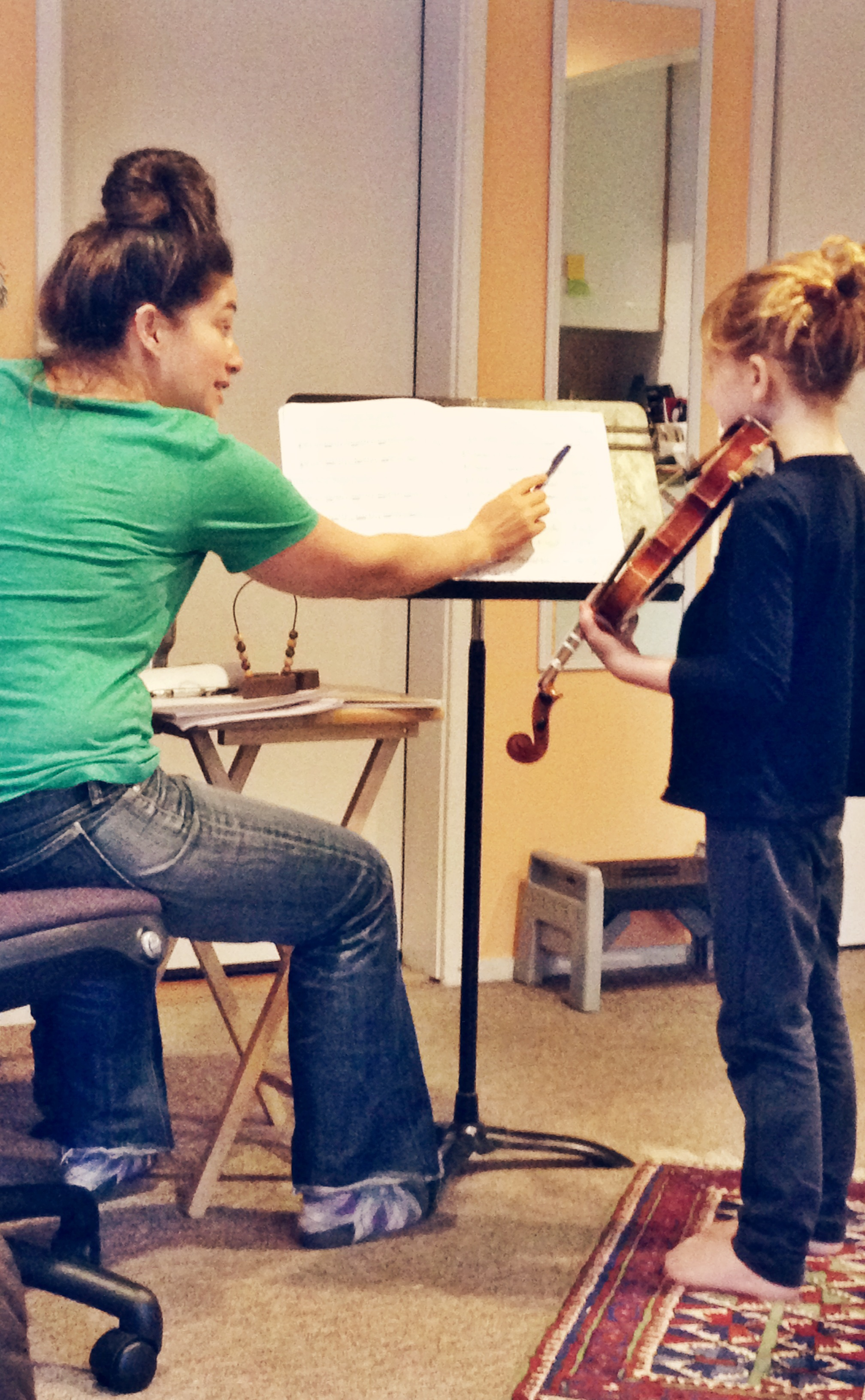 Toby teaching violin lesson