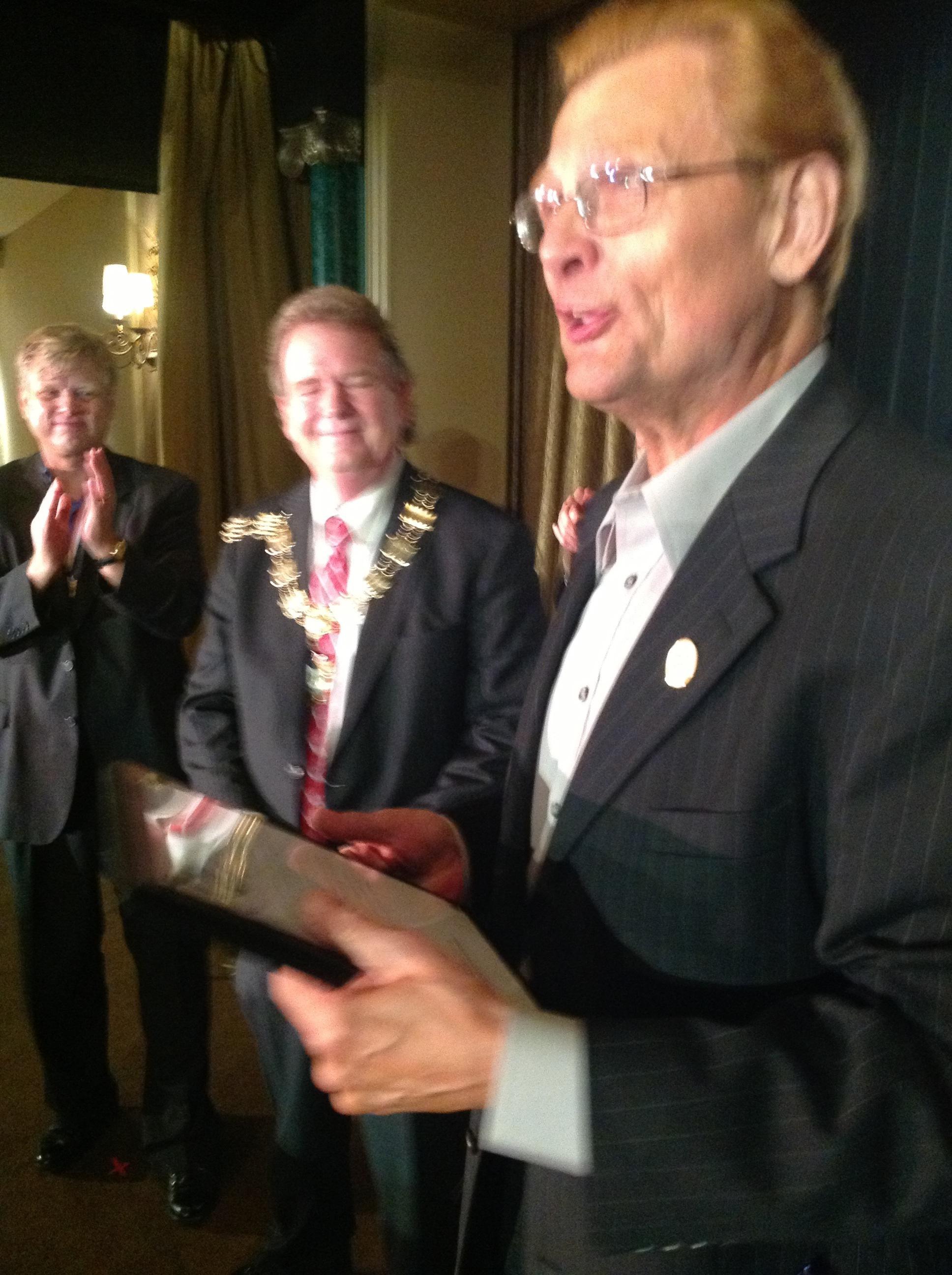 I.B.M. International President Bill Evans presented a certificate to Tom Mullica