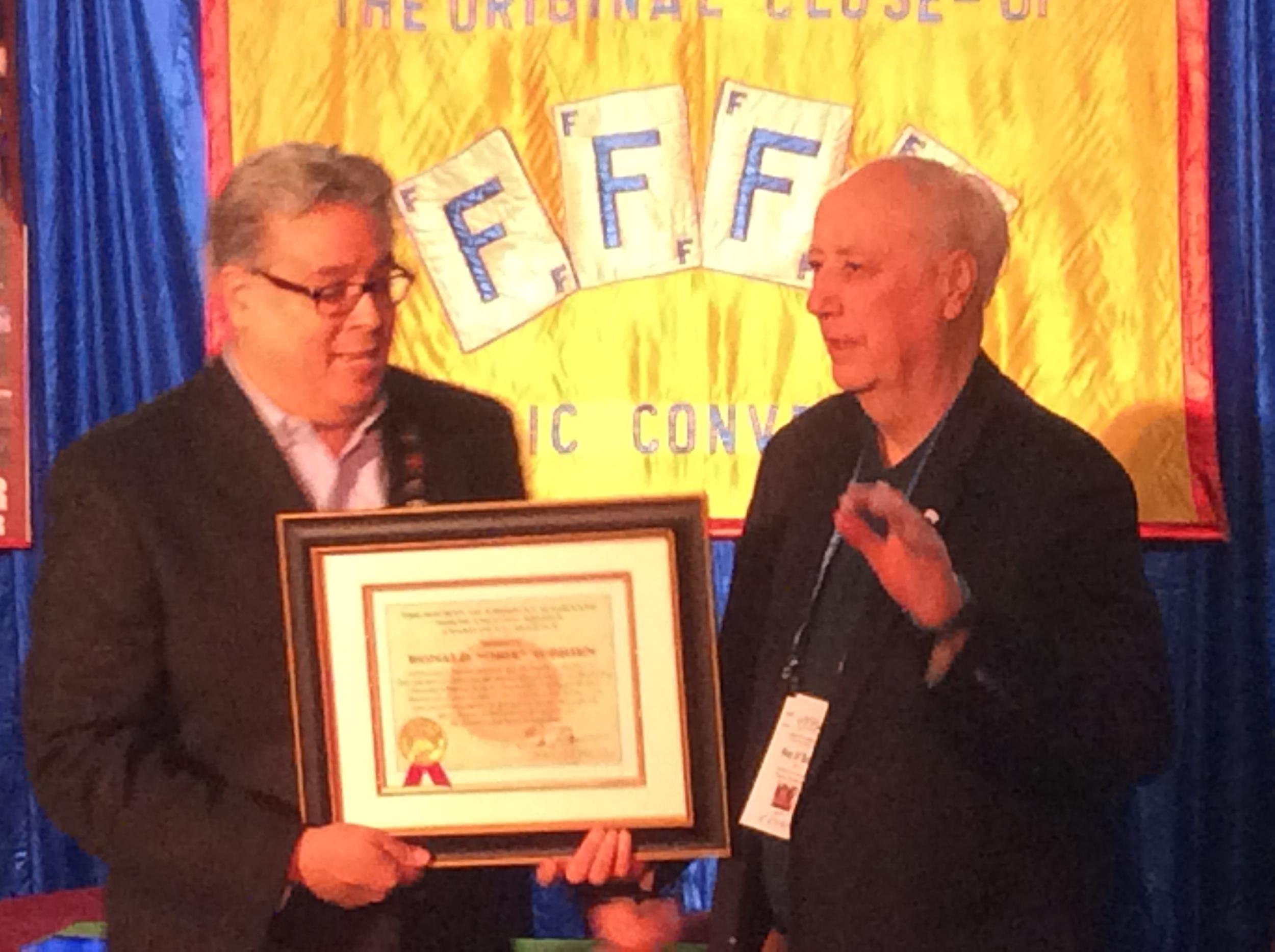 Eric DeCamps presents S.A.M. award to Obie O'Brien