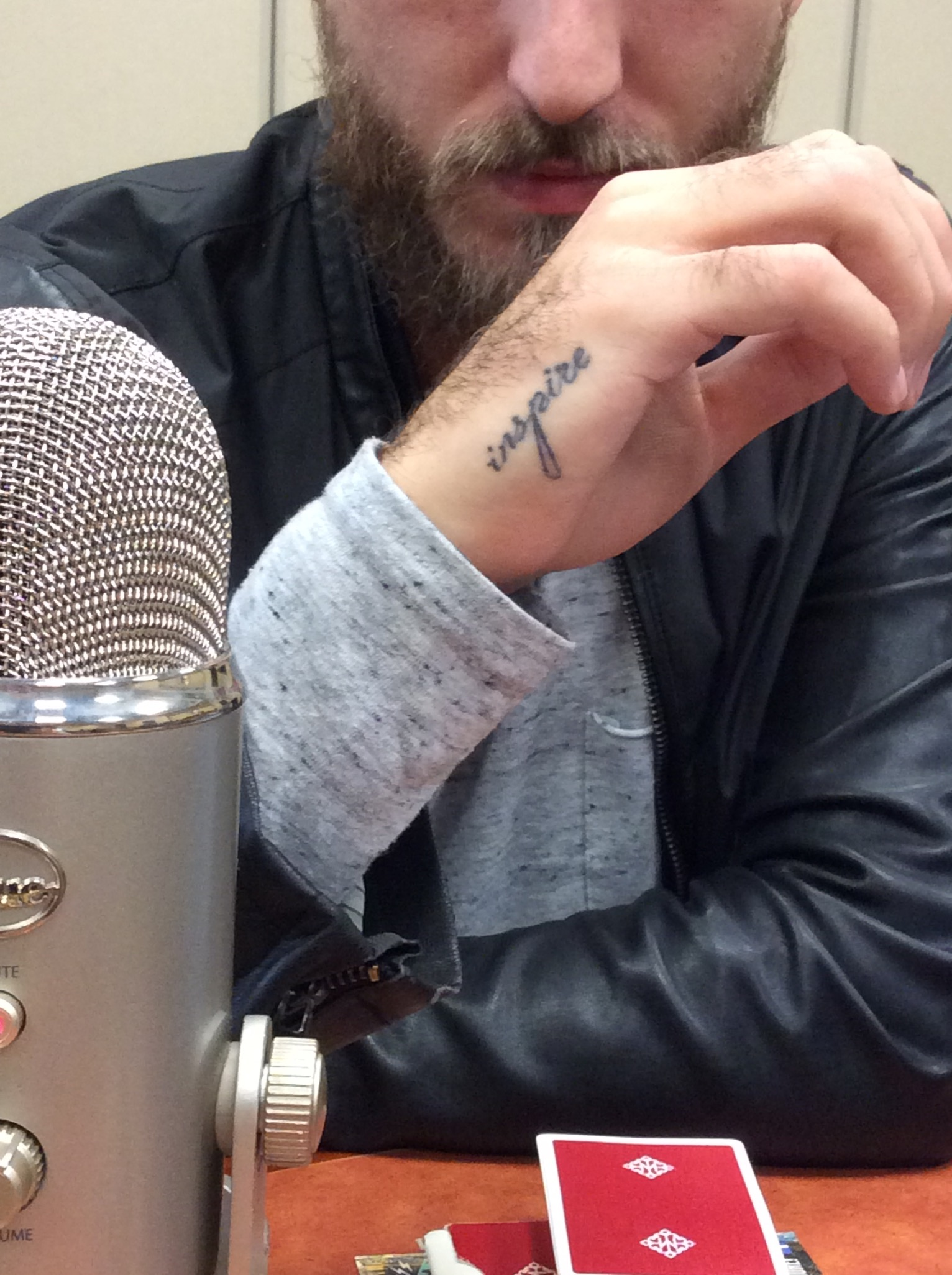 "His tattoo says, ""Inspire"""