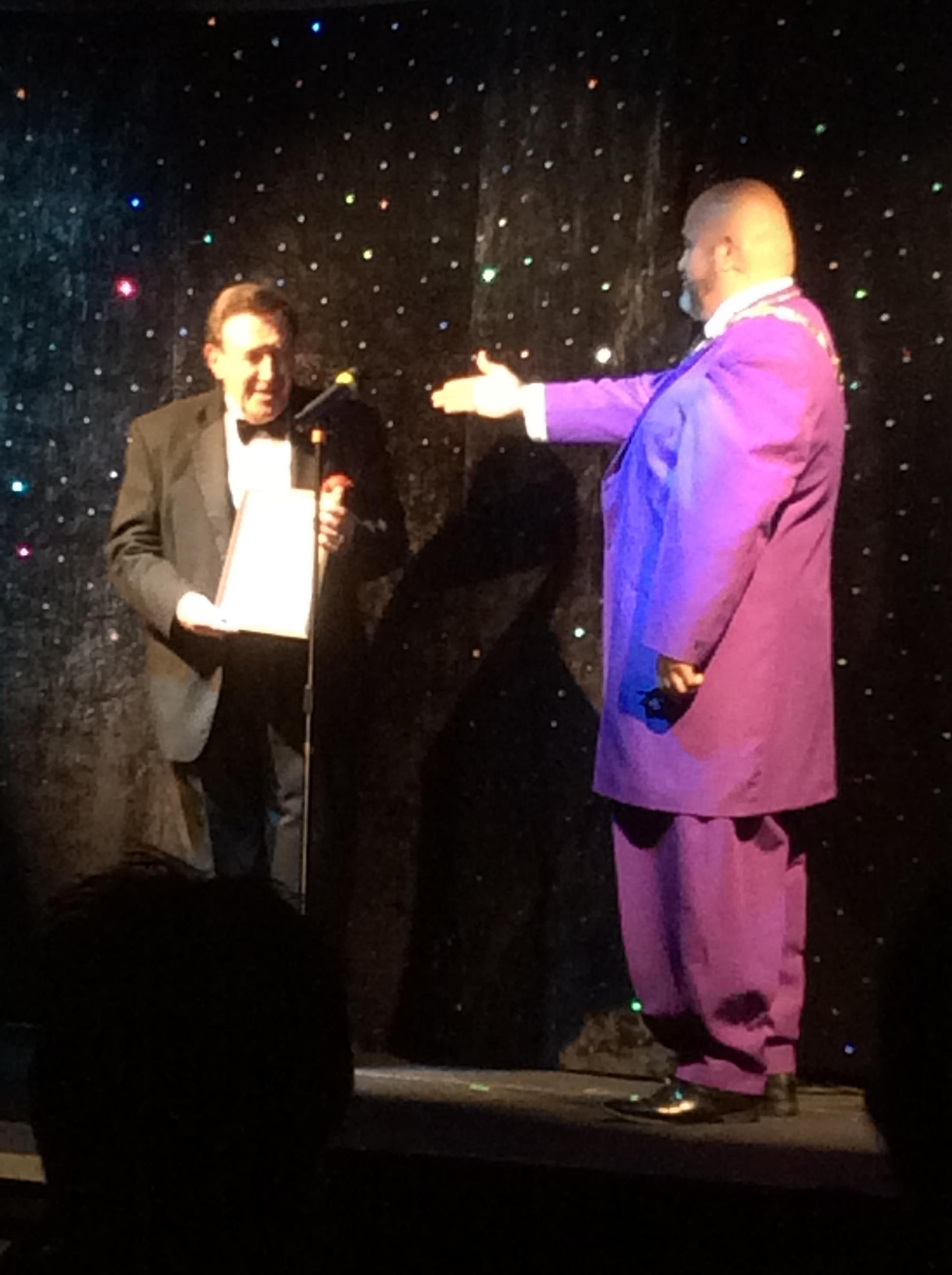 I.B.M. International President, Oscar Munoz awards a Presidential Citation to Scott Holingsworth