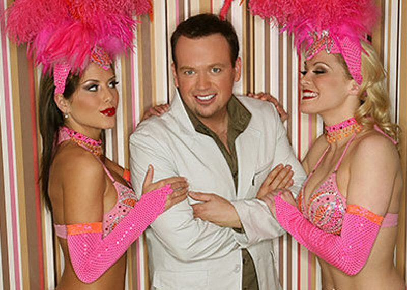 Nathan and showgirls.jpg