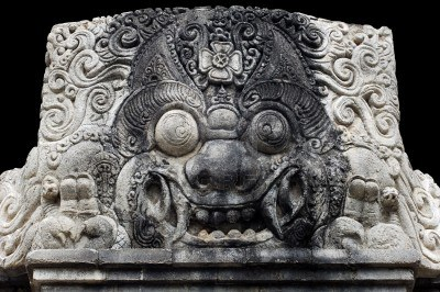 2592539-indonesia-bali-sculpture-of-kala--stone-sculpture-of-head-s-kala-traditionally-represented-in-the-to.jpg