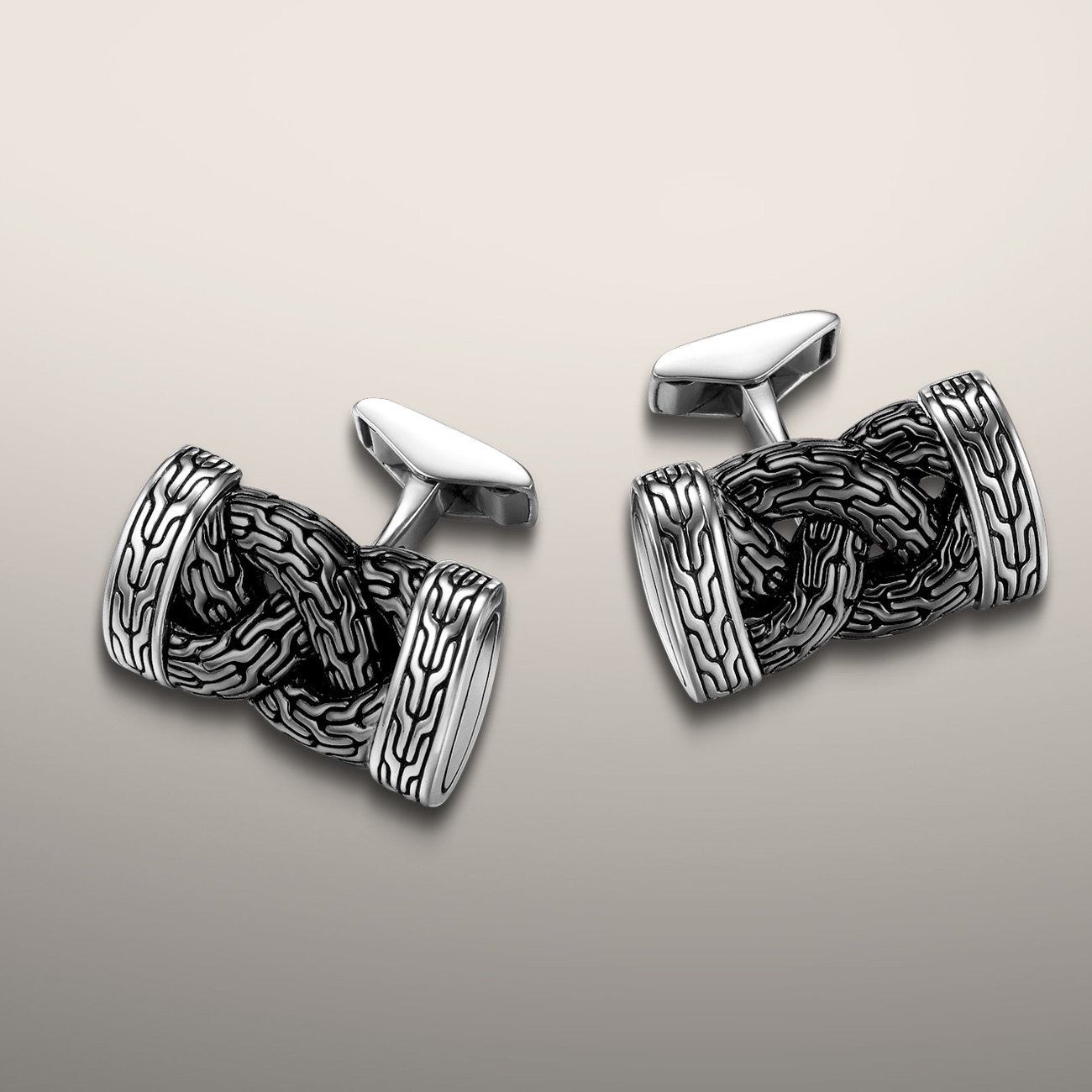 Two tone polished silver and anodized silver cufflinks. John Hardy's signature braided classic chain styling in contrasting colors. The dark and light makes this piece go with every shirt. Dress them up for a work meeting or dress them down for a cool flair to a sports shirt.  $395