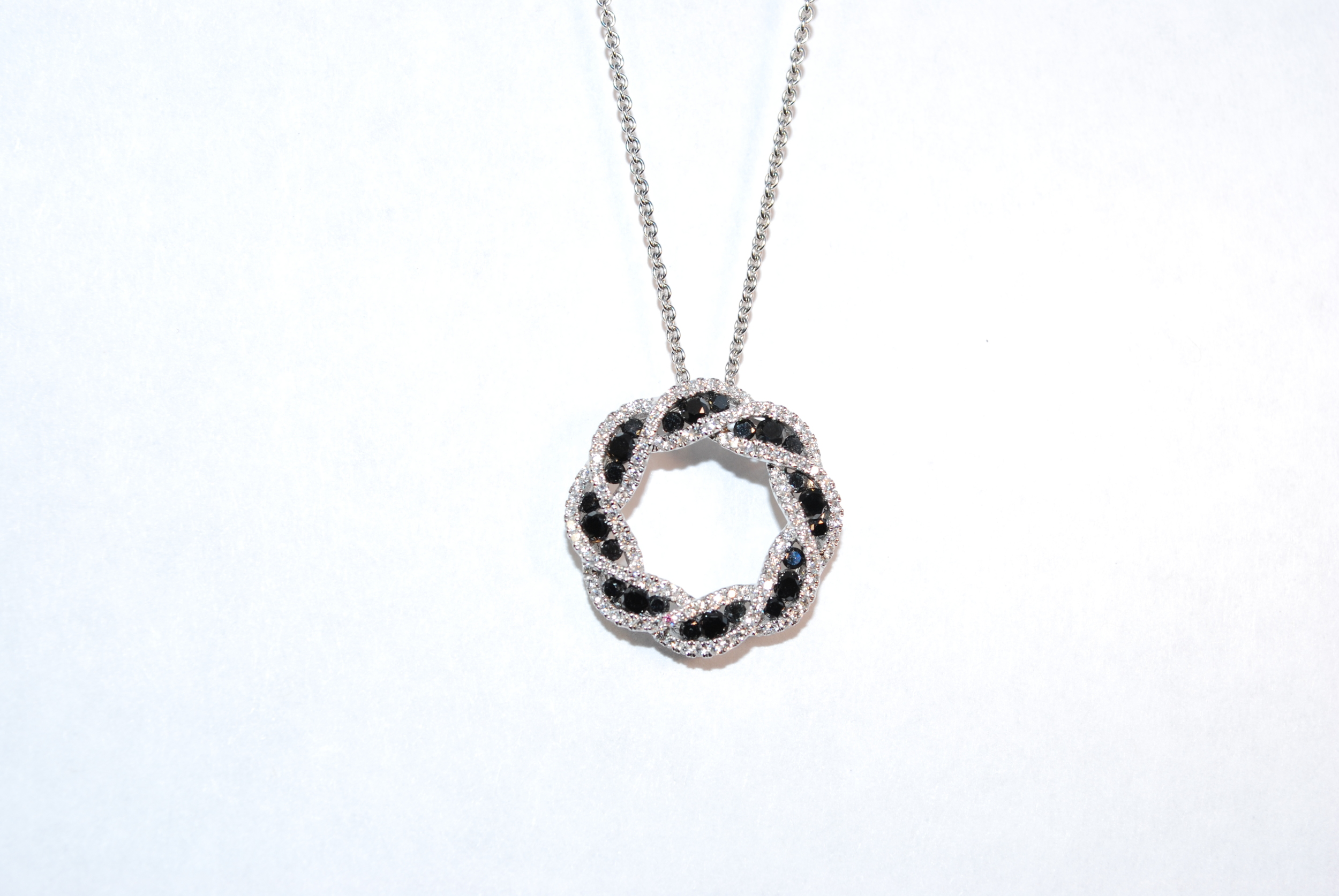 Black and white diamonds wreath pendant – circle of black diamonds and white diamonds intertwined in a gorgeous pendant. Beautifully cut black diamonds that sparkle white gold.  $5000