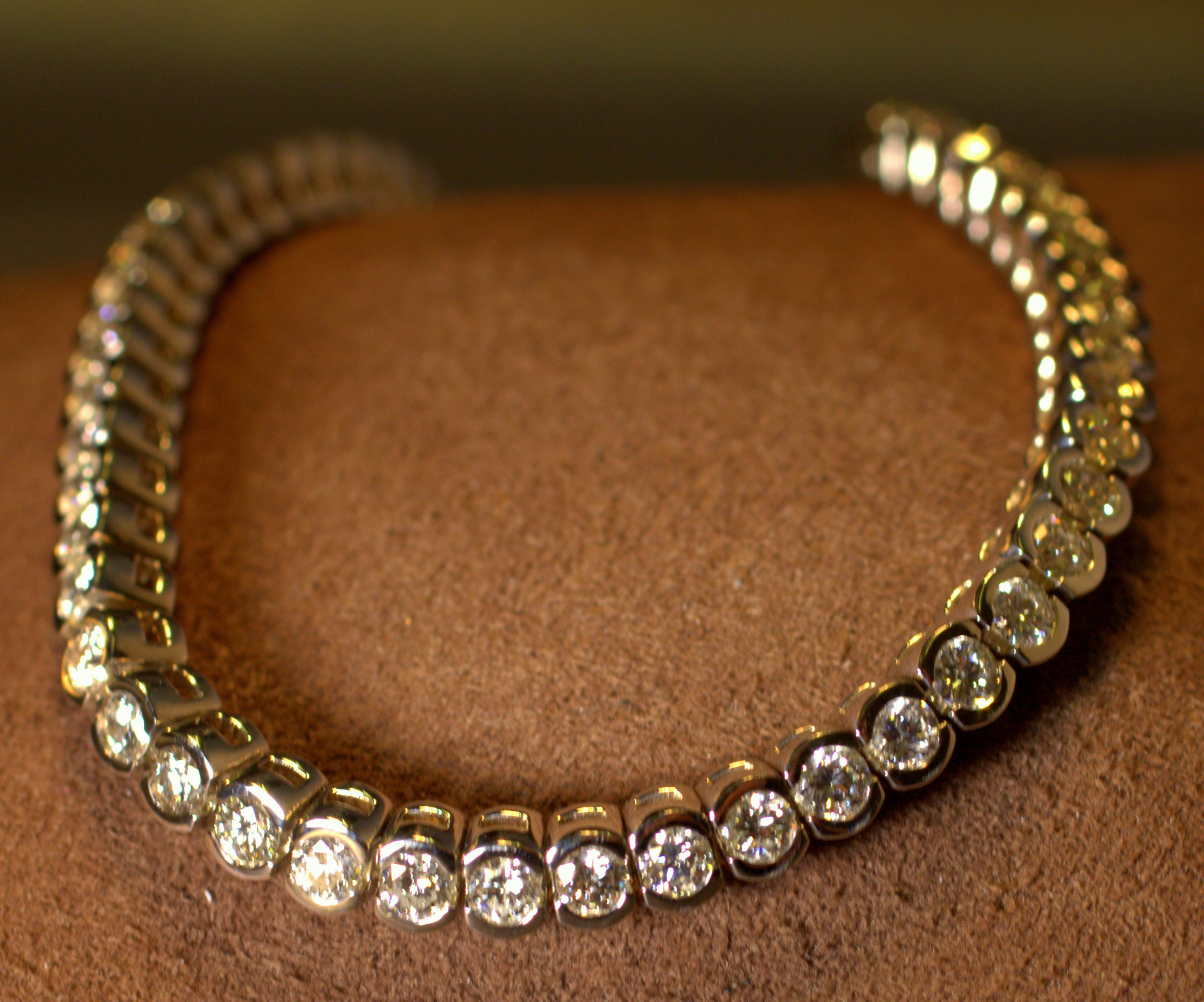 Classic chic half bezel diamond bracelet set with amazing cut diamonds that sparkle. 4.89 ct white gold diamond tennis bracelet for a modern look.  $8000