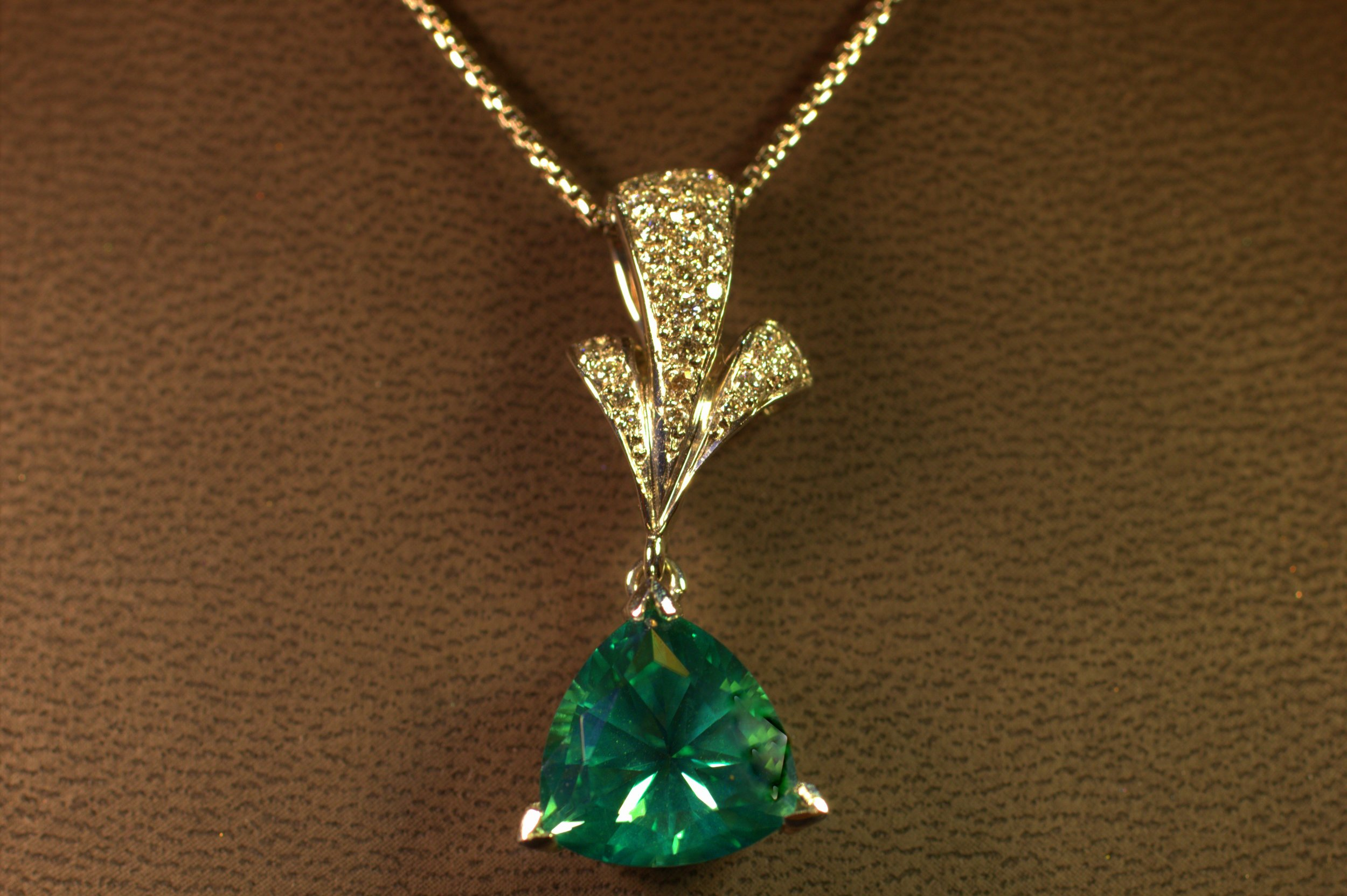 Custom seafoam green tourmaline custom pendant designed by Mark Schneider. Featuring a beautiful light seafoam green stone with diamond accent. Modern design with a classic twist.  $4750
