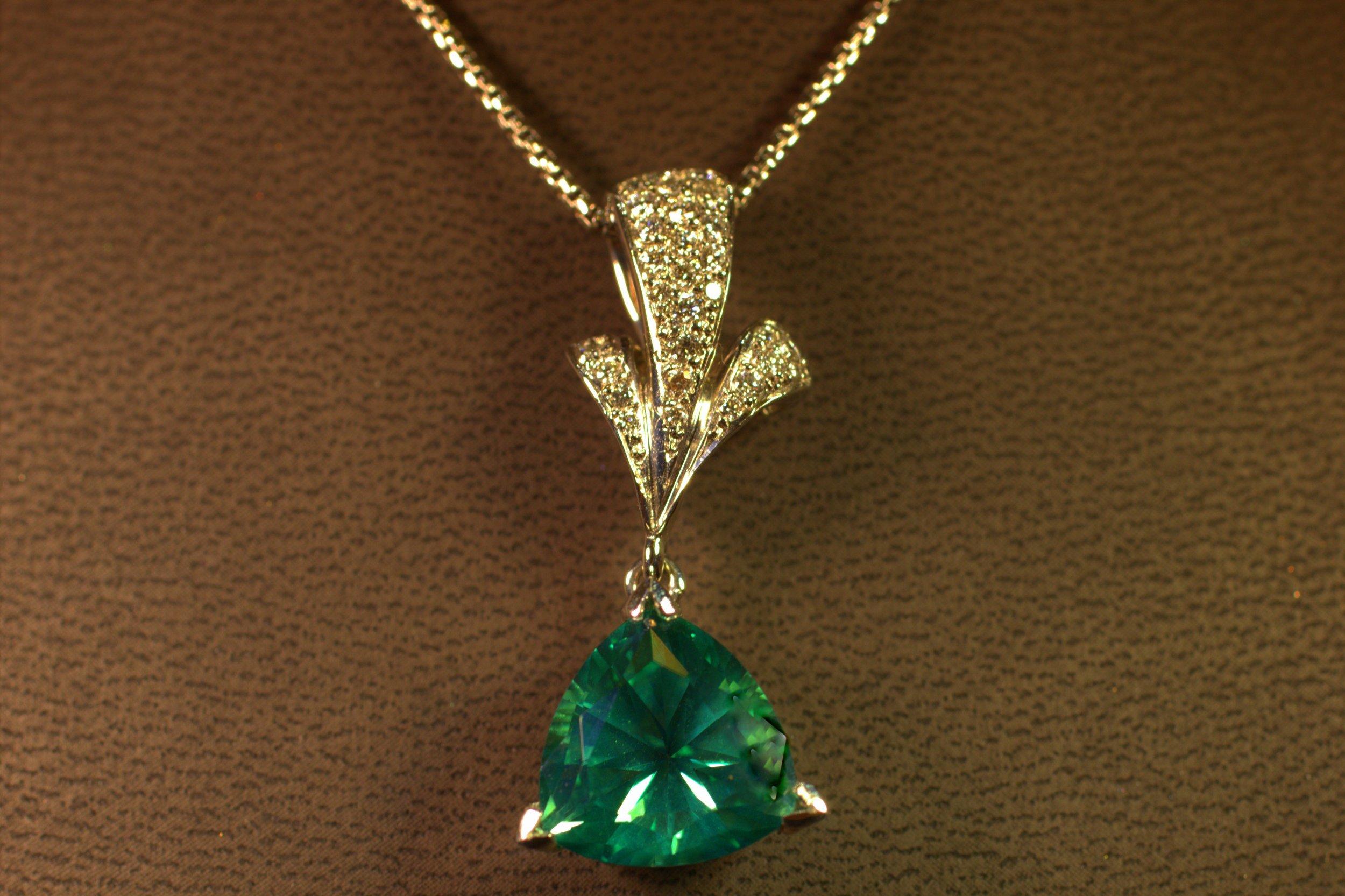 Custom seafoam green tourmaline custom pendant designed by Mark Schneider. Featuring a beautiful light seafoam green stone with diamond accent. Modern design with a classic twist.  $4750
