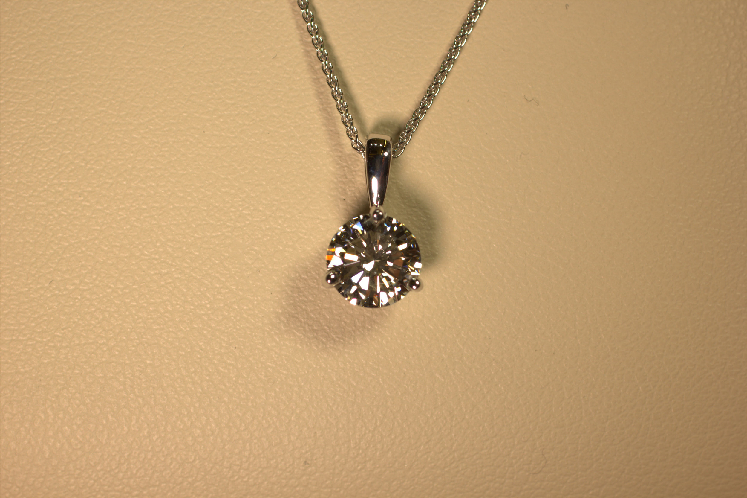 .26 carat diamond solitaire pendant. This classic piece is the perfect gift for any woman. Anyone who doesn't have one wants one. The piece is very versatile, it can be dress up any outfit or be the perfect complement to elegant attire.   $600