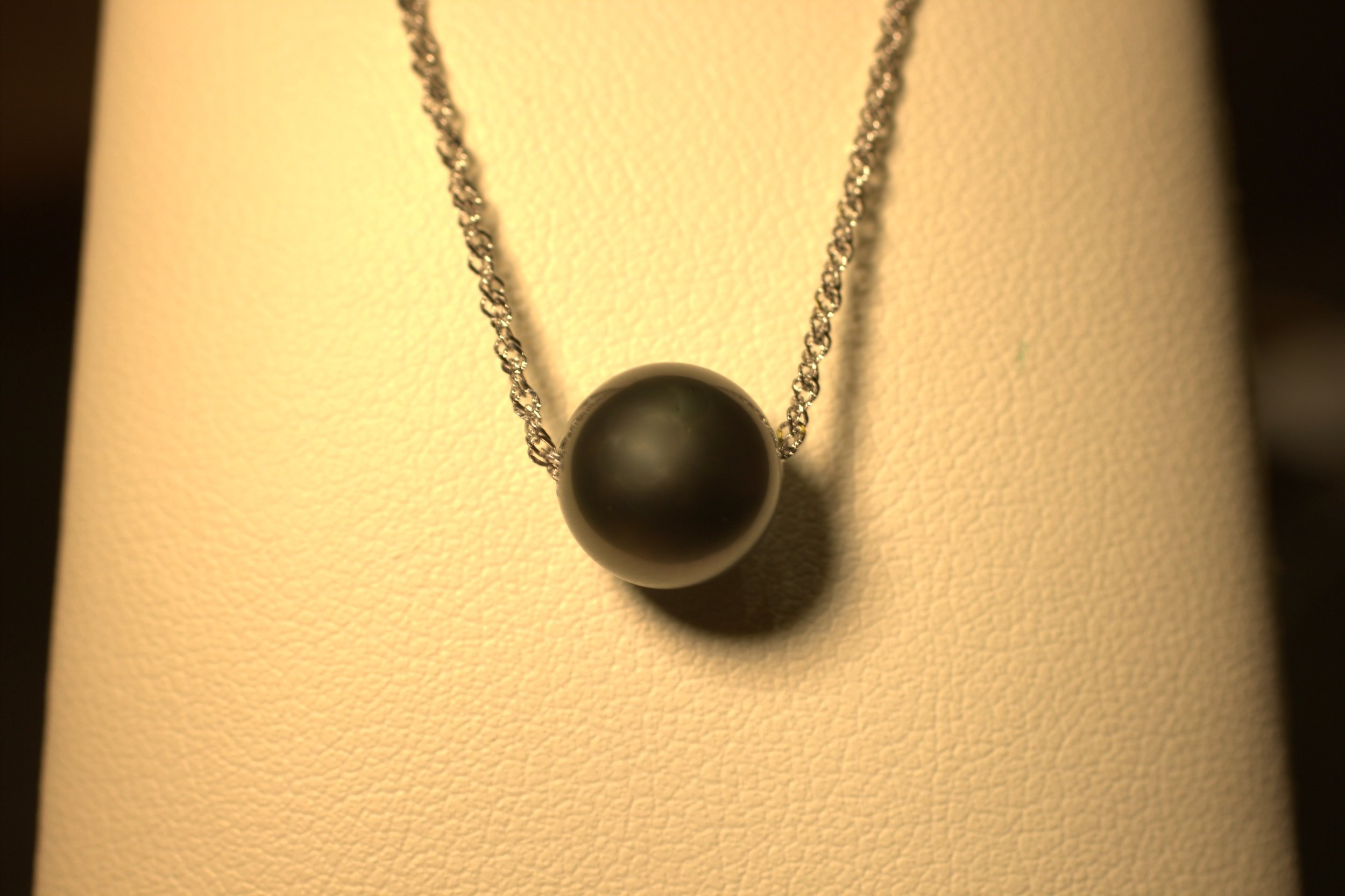 floating black tahitian pearl on white gold chain no bail just moves on the chain great luster and shine mastoloni pearls prettiest pearls on earth at Marlen Jewelers in Rocky River just minutes from Cleveland.jpg