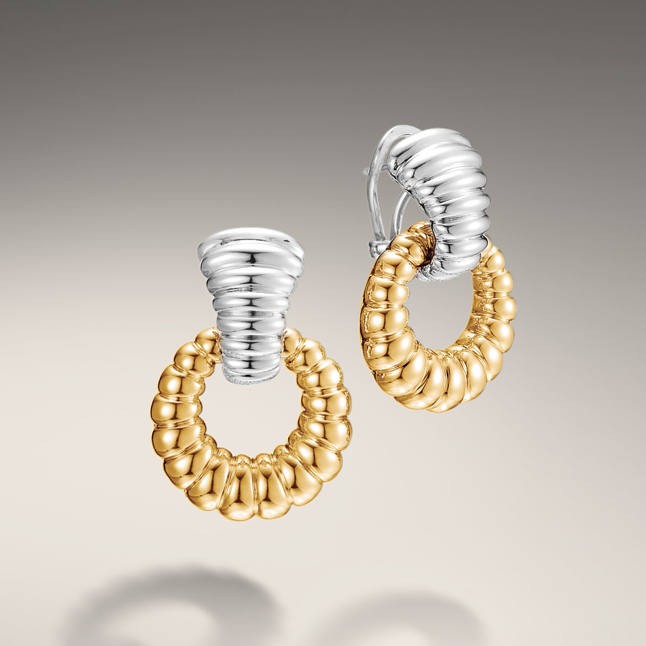 John Hardy doorknocker earrings. Silver and 18k yellow gold that really pops. From John Hardy's classic Bedeg Collection.  $1195