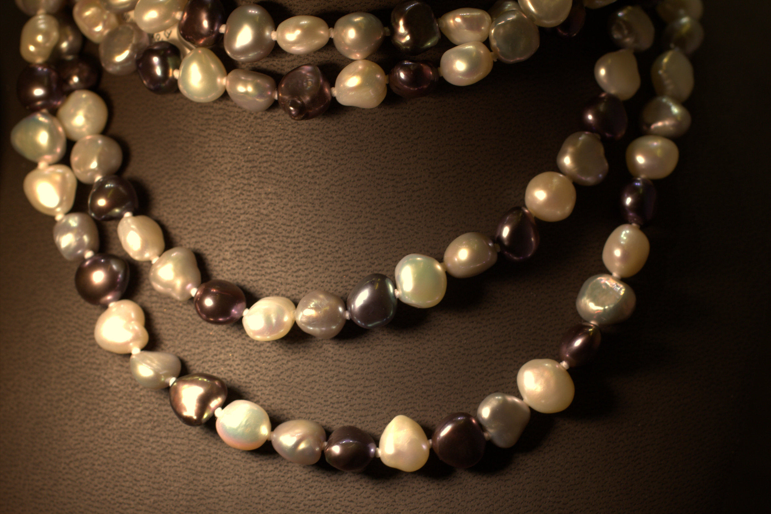 Classic yet chic54 inch strand of natural black and white freshwater pearls with color enhanced burgundy purple pearls. Hottest new trend, and great gift idea.  $250