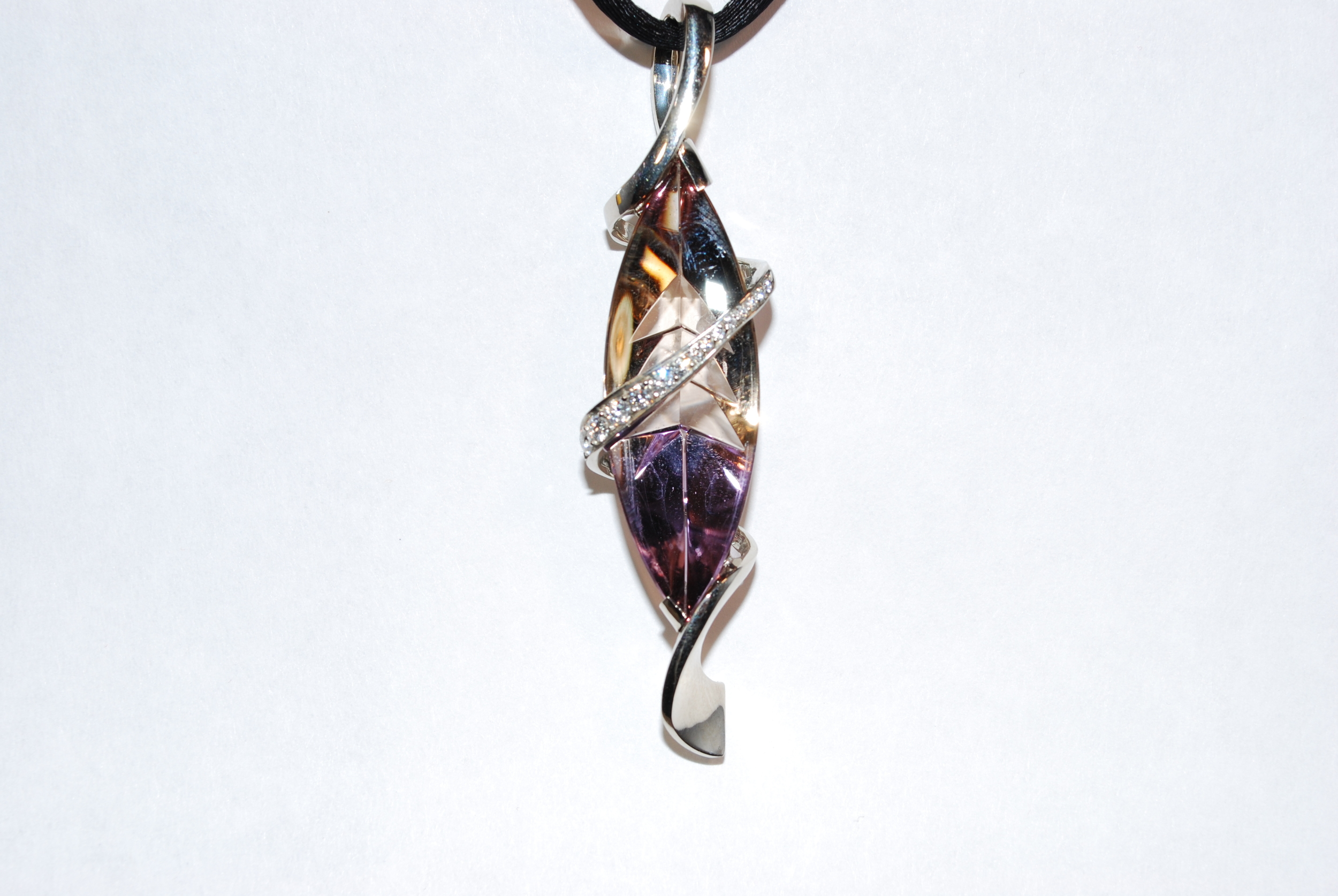 Mark Schneider custom designed ametrine. Amethyst and citrine grow in the same vein with a diamond swirl black cord. Beautiful, contemporary modern look.  $7500