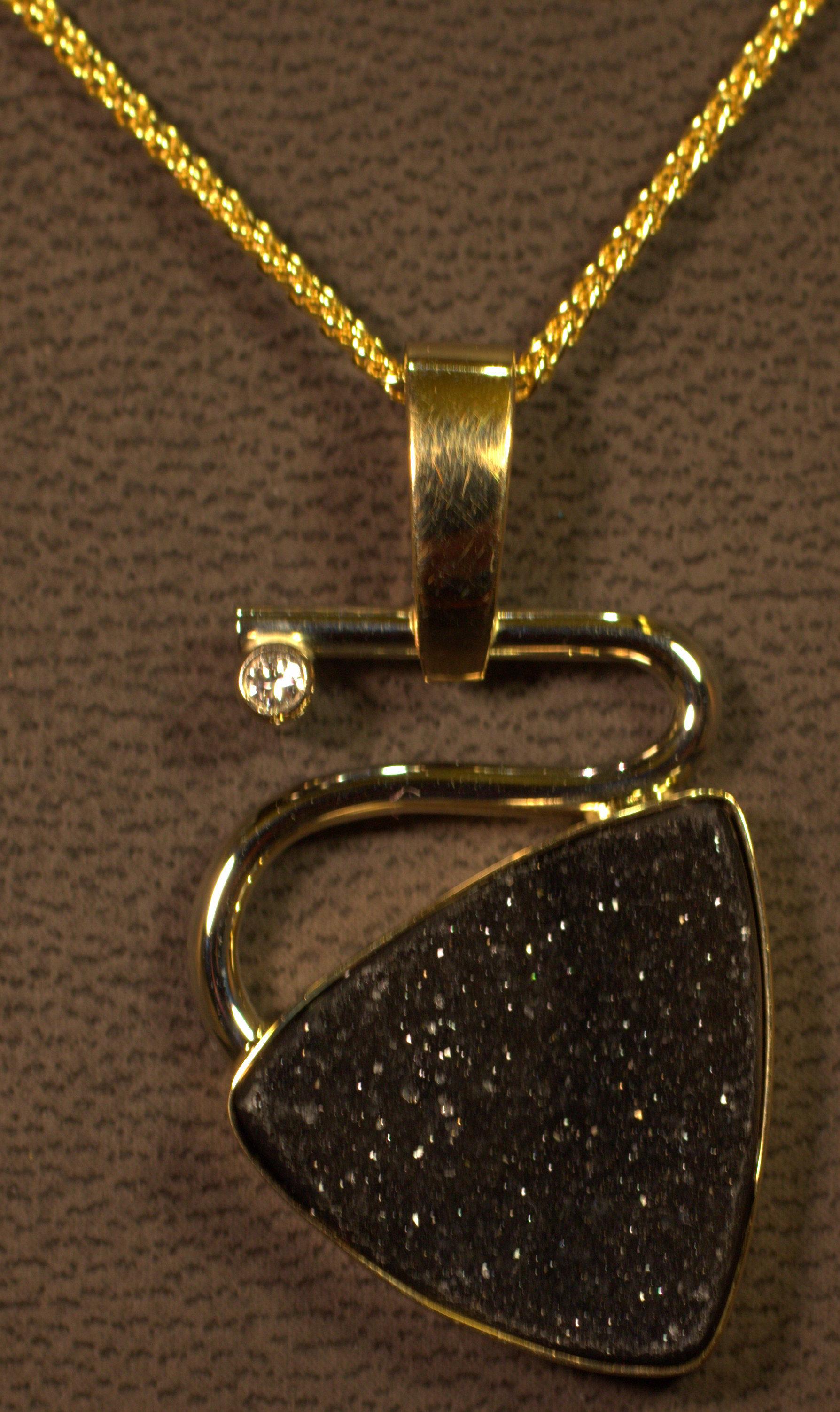Modern styling contemporary drusy quartz and diamond pendant. 14 karat two tone gold on 14 karat yellow gold chain.  $1675