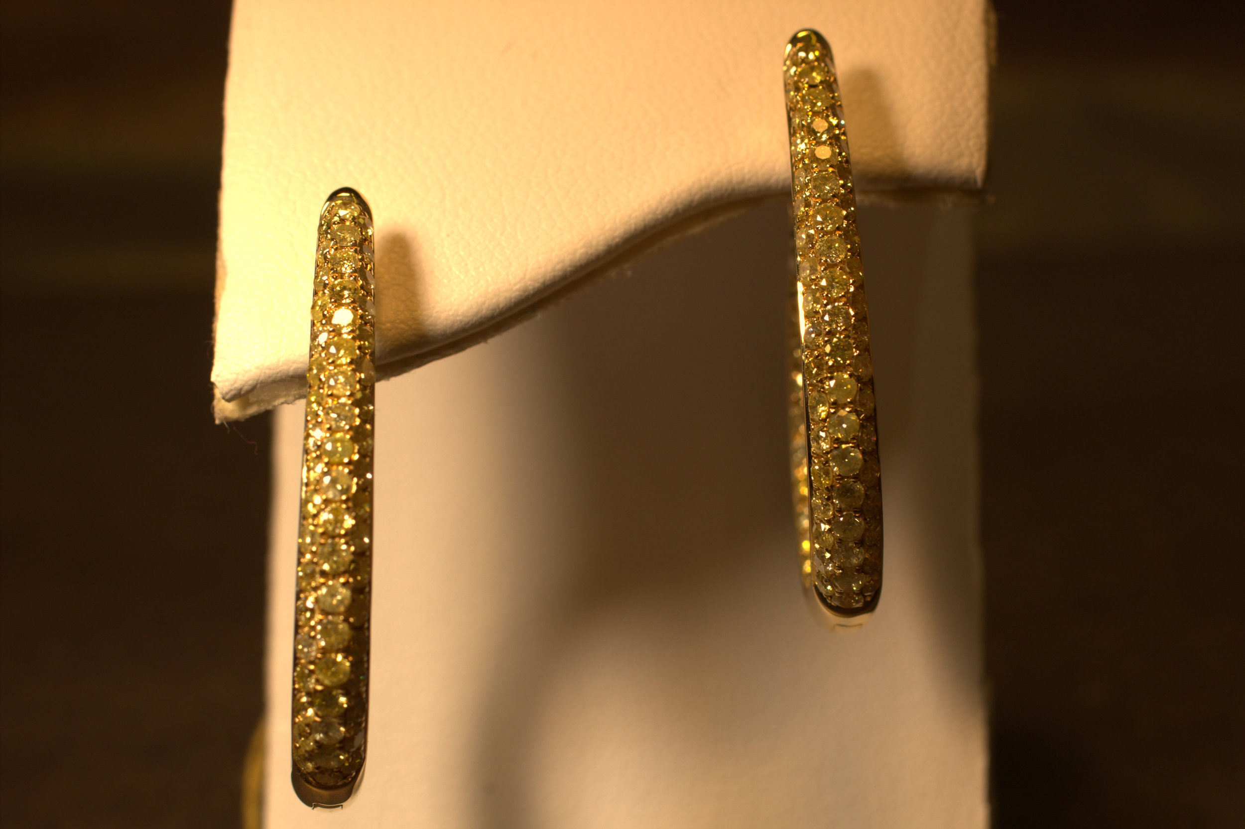 P ave set fancy yellow diamond, canary hoop earrings. Yellow gold and inside out diamonds on both sides.     $7000
