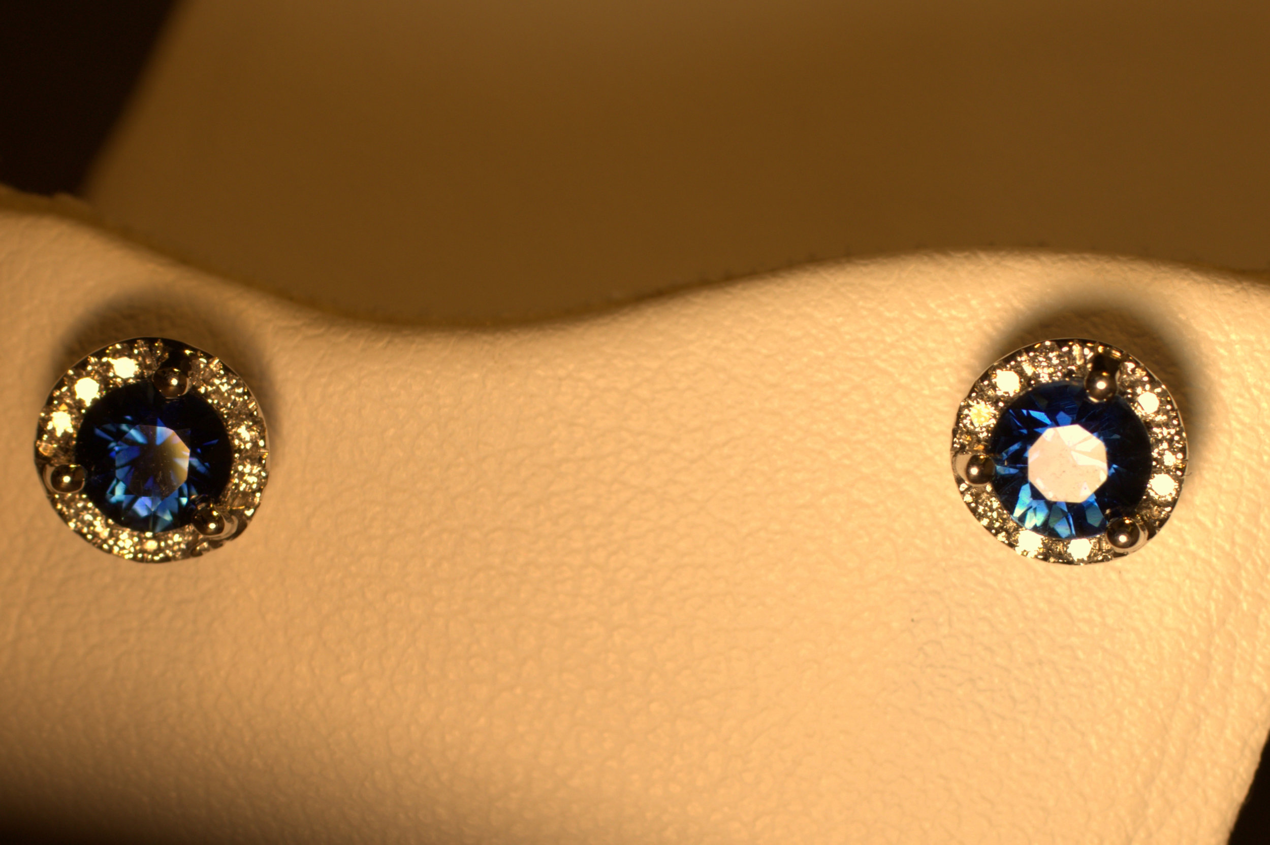 Beautiful blue sapphire studs with a sparkling diamond halo. Perfect for daily wear.    $1275