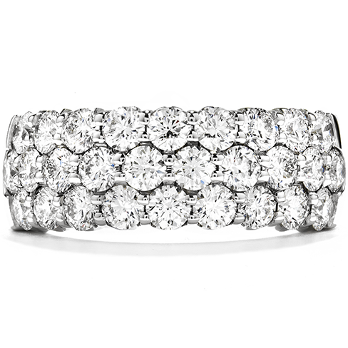 Triple row right hand ring. Hearts on fire diamonds give brilliant sparkle. A stunning wedding band.  $8600