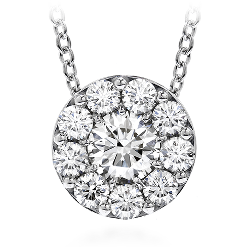 Hearts on Fire Fufillment Pendant 1.00 carat total weight fashioned in 18 karat white gold. One center diamond encircled by 9 smaller diamonds giving the look of a very large solitaire pendant. The diamonds are each individually set in a bezel made for each individual piece to ensure a seamless smooth look.