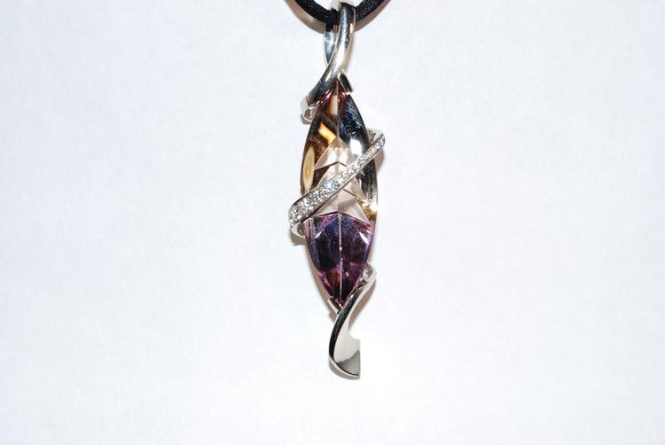 Mark Schneider custom designed ametrine. Amethyst and citrine grow in the same vein with a diamond swirl black cord. Beautiful, contemporary modern look.$7500