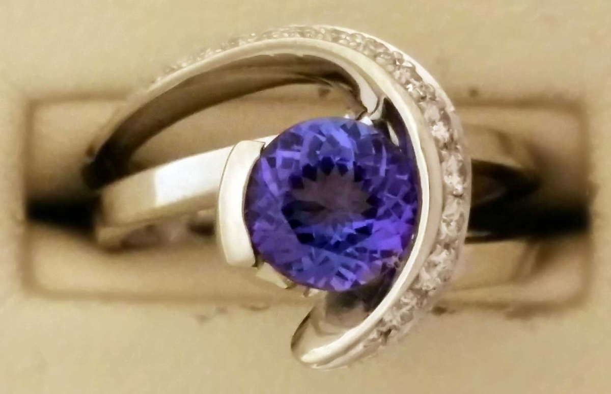 Grand Prize Drawing on December 31, 2014 – a custom made Mark Schneider Design ring featuring a1.09ct tanzanite gemstone and.25ct diamonds nested in a 14k white gold setting.