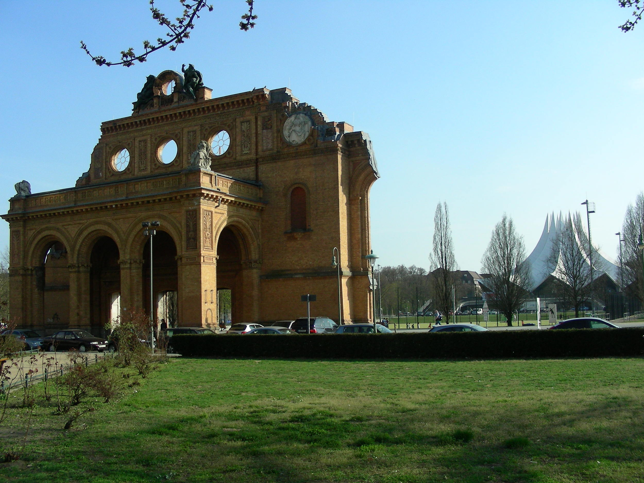 The remaining facade of the Anhalter Bahnhof. In the background you can see a sports field and the Berlin Tempodrom.