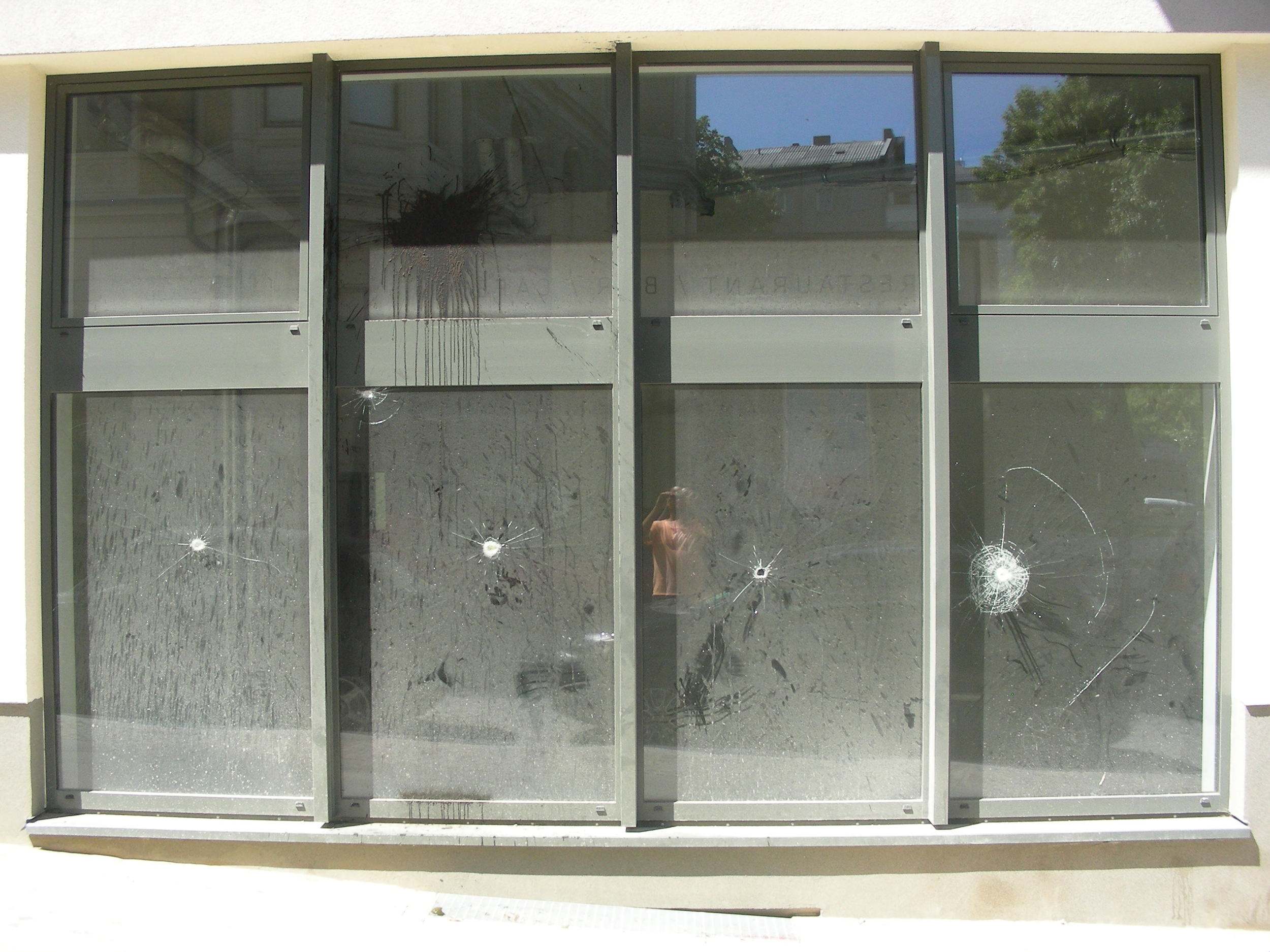 Smashed ground floor windows.