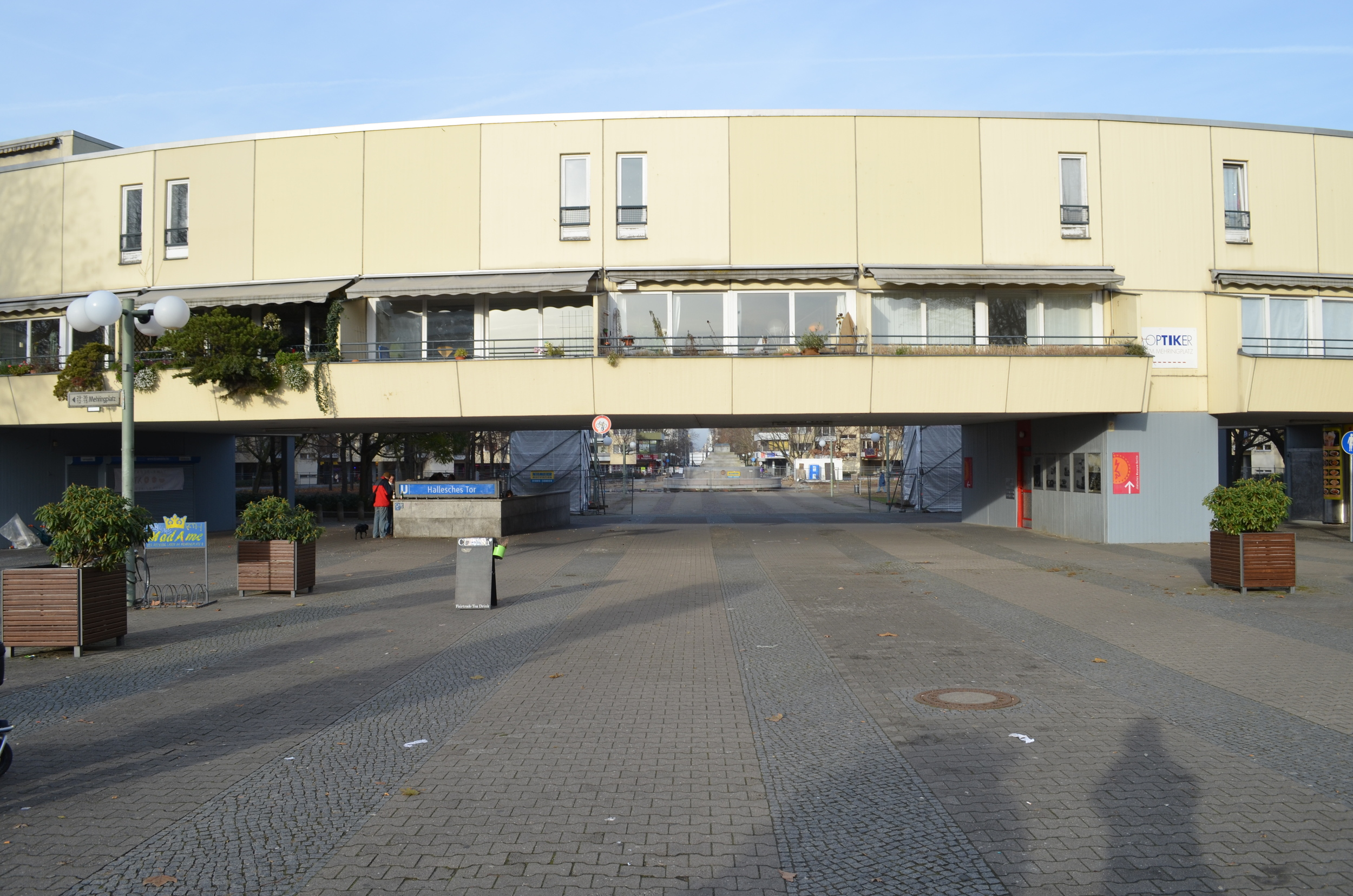 A circular residential building. The complex consists of an inner circular building and then a series of outer buildings.