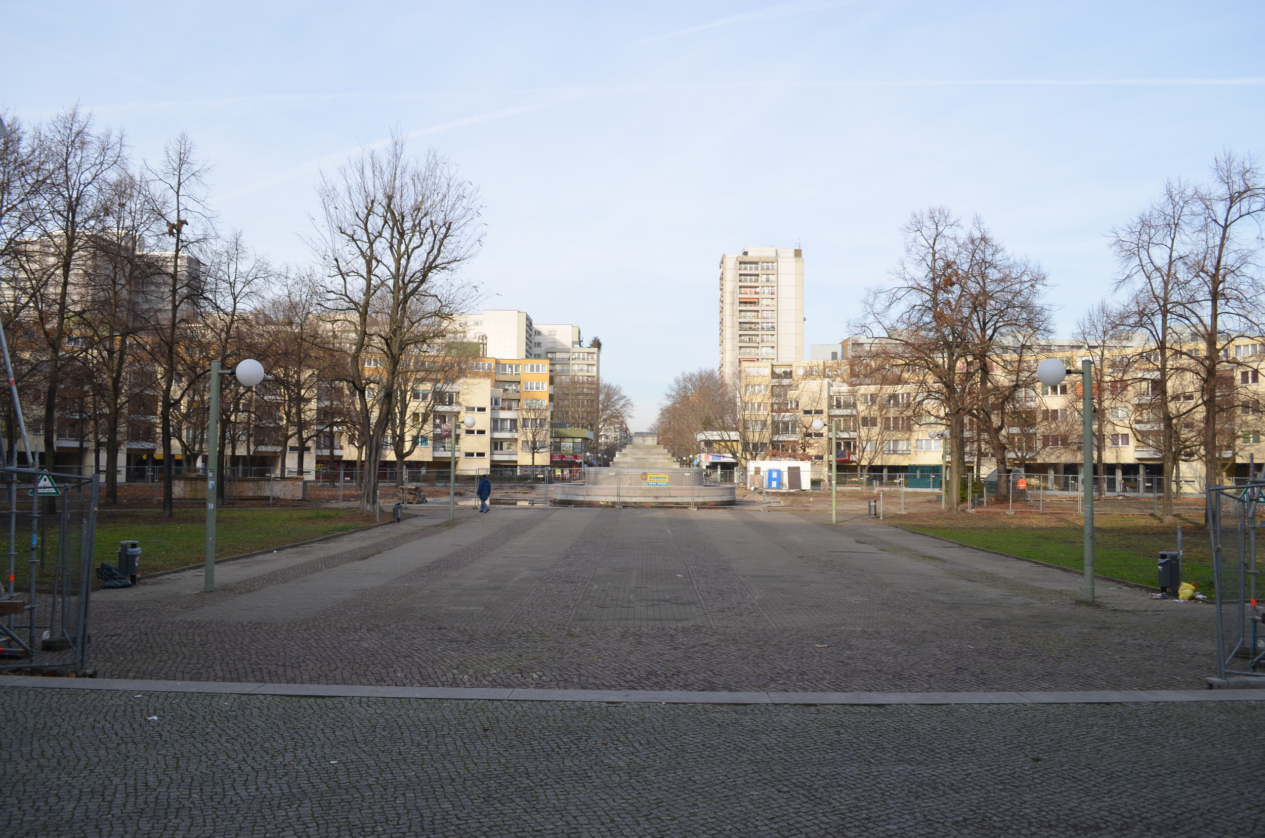 The park inside the ring of buildings. The memorial in the center is currently being refurbished.