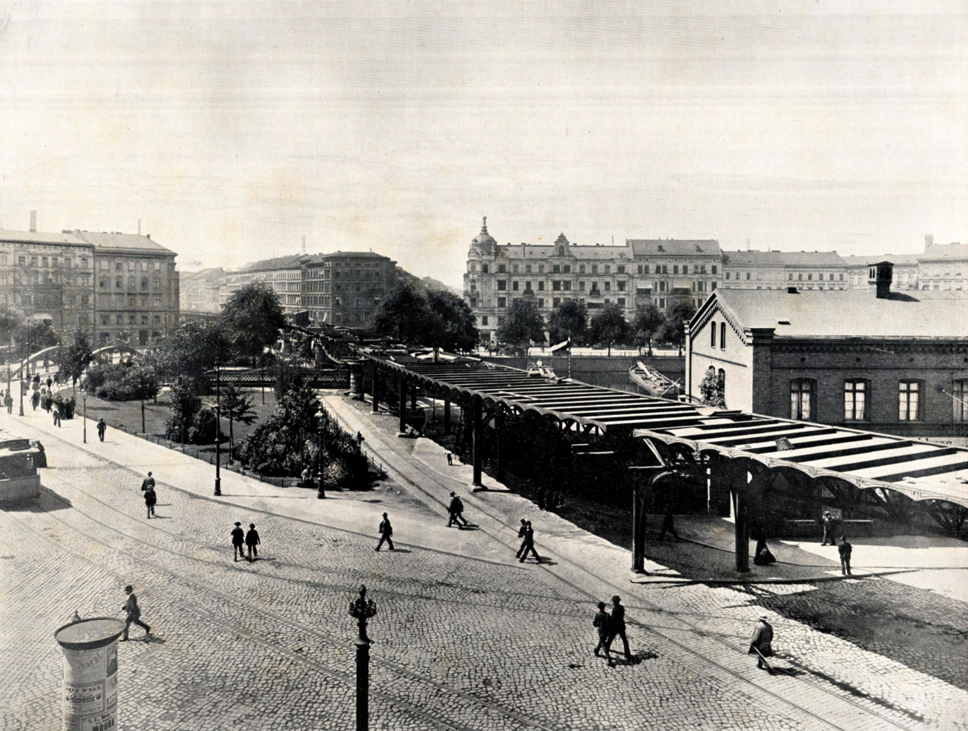The tracks of the Berlin Connector Train are at the bottom left of this image. The viaduct under construction to the right is today's U-1 train line. Photo credit:  creative commons.