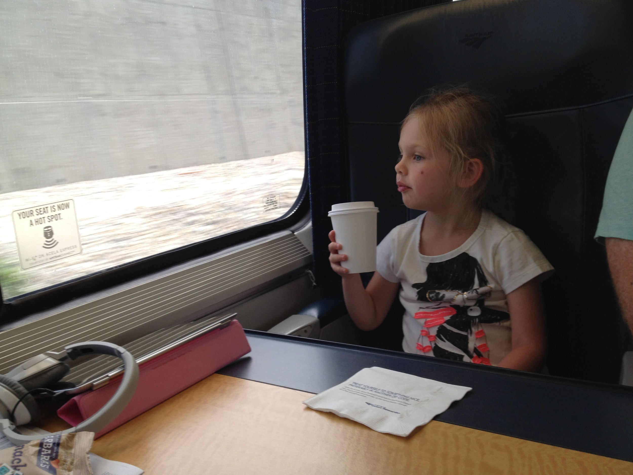 Paley on her first train ride from NYC to Boston.....coffee in hand.....nah, hot coco.