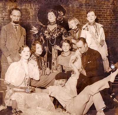 Impersonation Party, 1927: Among the revellers are Cecil Beaton (back left), Tallulah Bankhead (front right), Elizabeth Ponsonby (in black hat), and (front row left) Stephen Tennant as Queen Marie of Romania