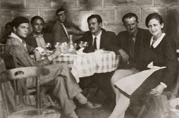 Harold Loeb (far left) and Hemingway (center with black tie)