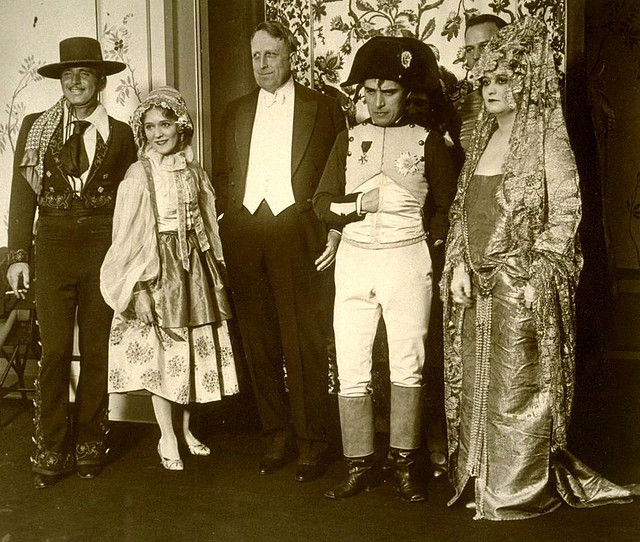 Fairbanks, Pickford, William Randolph Hearst, Charlie Chaplin and Millicent Hearst at their hollywood mansion in the late 20's. No clue who the two men are standing behind the group. Although that might be a the tall D.W. Griffith behind Millicent.