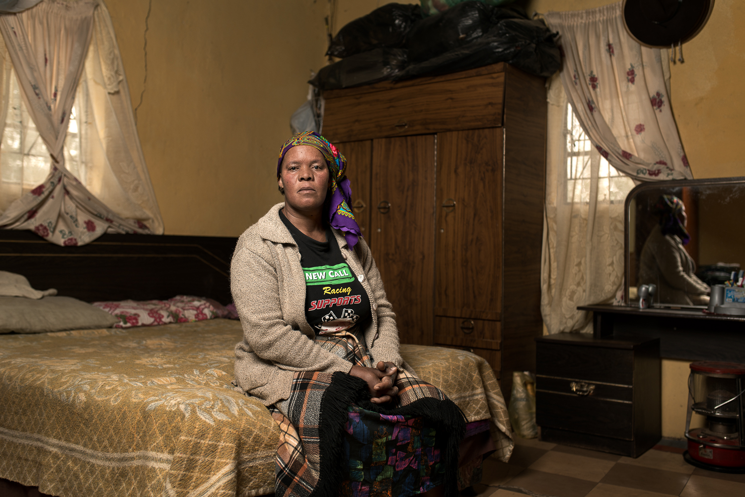 "Makeneude Agnus Litabe  is the widow of Michael Litabe who passed away in 2014 at the age of 60 years. She is 49 and lives in Motemekoane near Maseru in Lesotho. Her late husband worked on the mines for 29 years and received R38 000 when he was diagnosed with silicosis. She now has to survive by growing vegetables and farming cattle on her own. Her eldest daughter works as a domestic worker in Pretoria and sends home R1 000 every 3 or 4 months. ""Before my husband died he lost a lot of weight and his skin became black. He was in a lot of pain. I feel that the mine must be liable."""