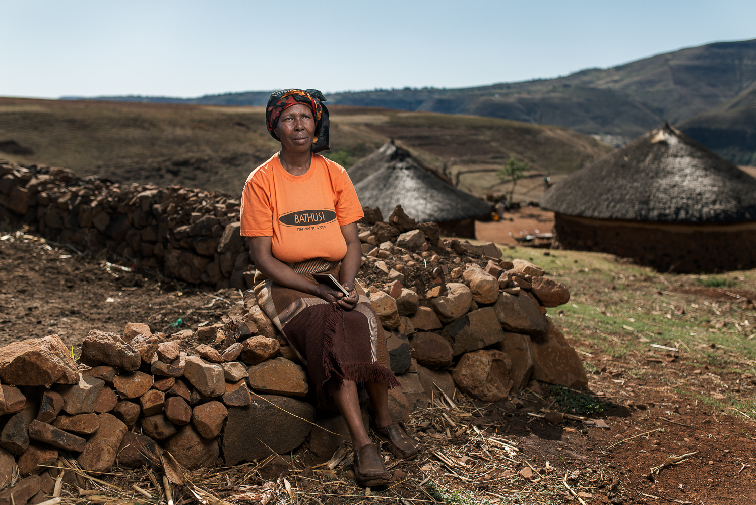 "Mataso   Makone,  the Widow of Molupe Makone, is 51 years old and lives in Butha Buthe, Lesotho. Her husband worked on the mines for 33 years, between 1974 and 2007 and died from tuberculosis in 2011. He was retrenched due to his medical condition but never received any compensation. Now she has to survive with money she receives from her daughters who are domestic workers in South Africa. Speaking about why she married a miner she said that they met when she was 16, he sent a friend to tell her that he was interested. ""I liked him a lot also,"" she said. ""Since he was already working I felt safe with him because I knew he was going to provide""."