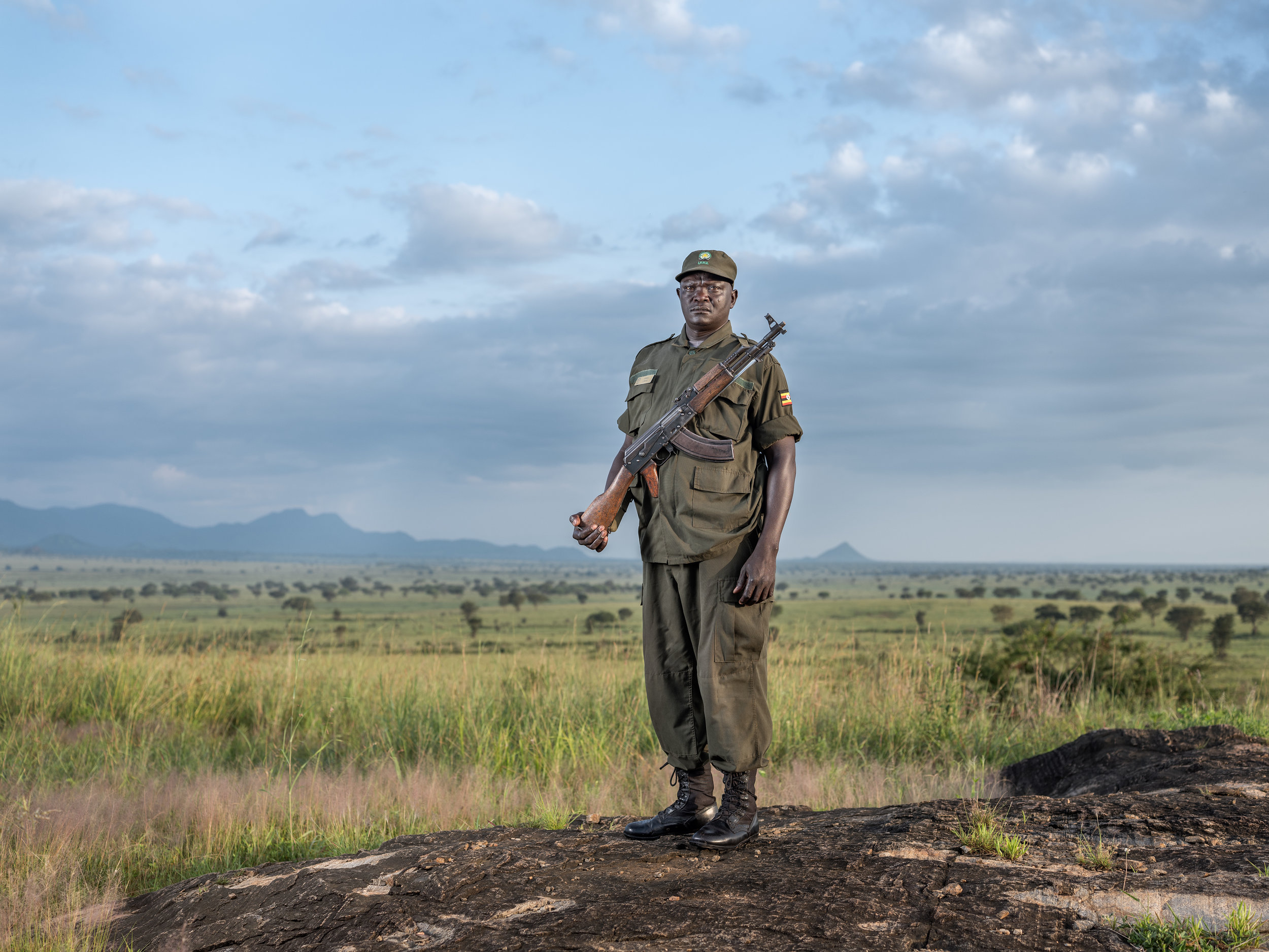 Samuel Loware in front of the mountains of South Sudan