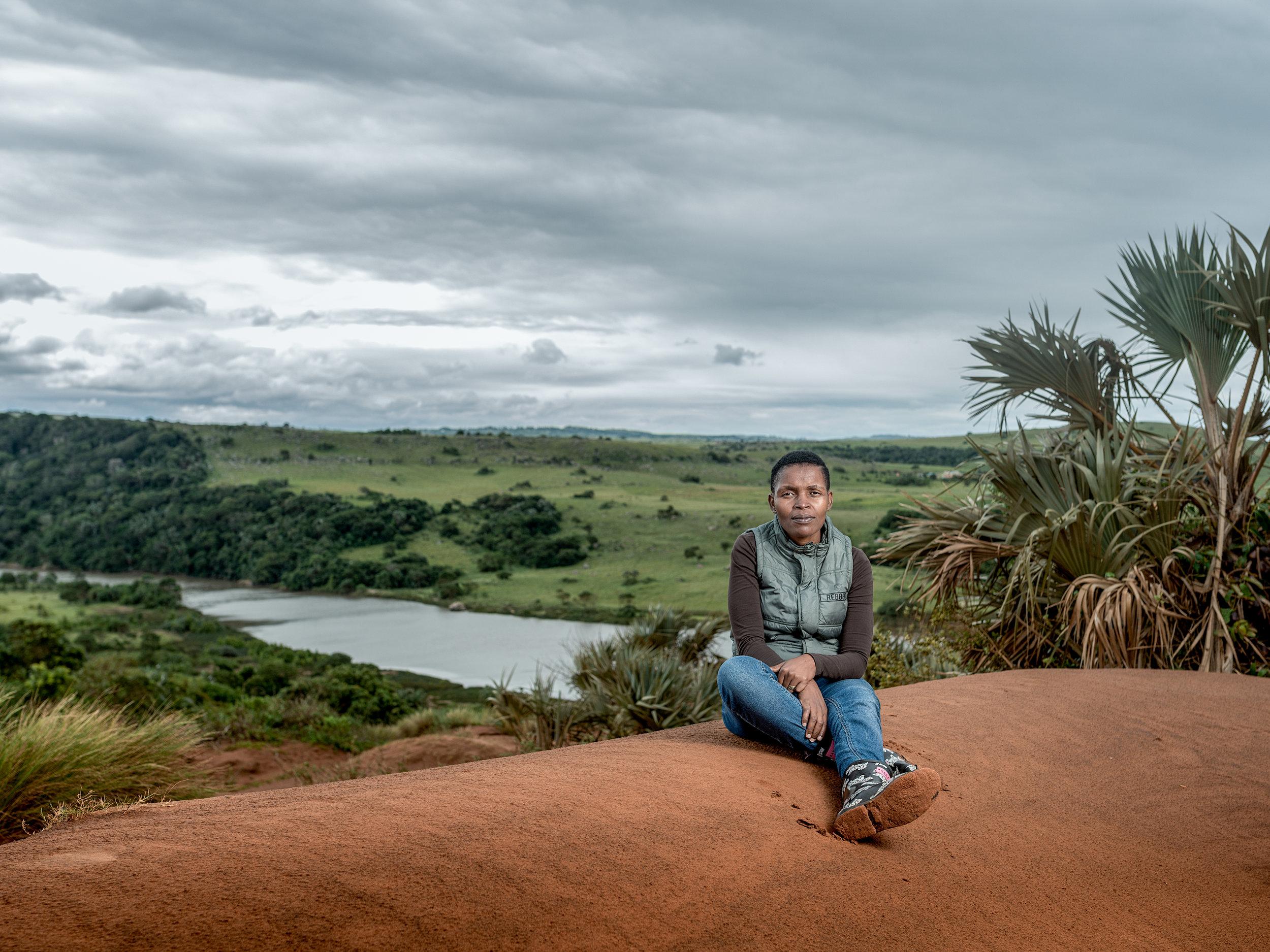 Nonhle Mbuthuma on the red sand dunes of Xolobeni
