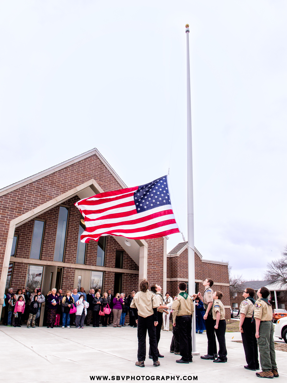 A Northwest Indiana boy scout troop raises the American flag at the grand opening of the new Griffith Library.