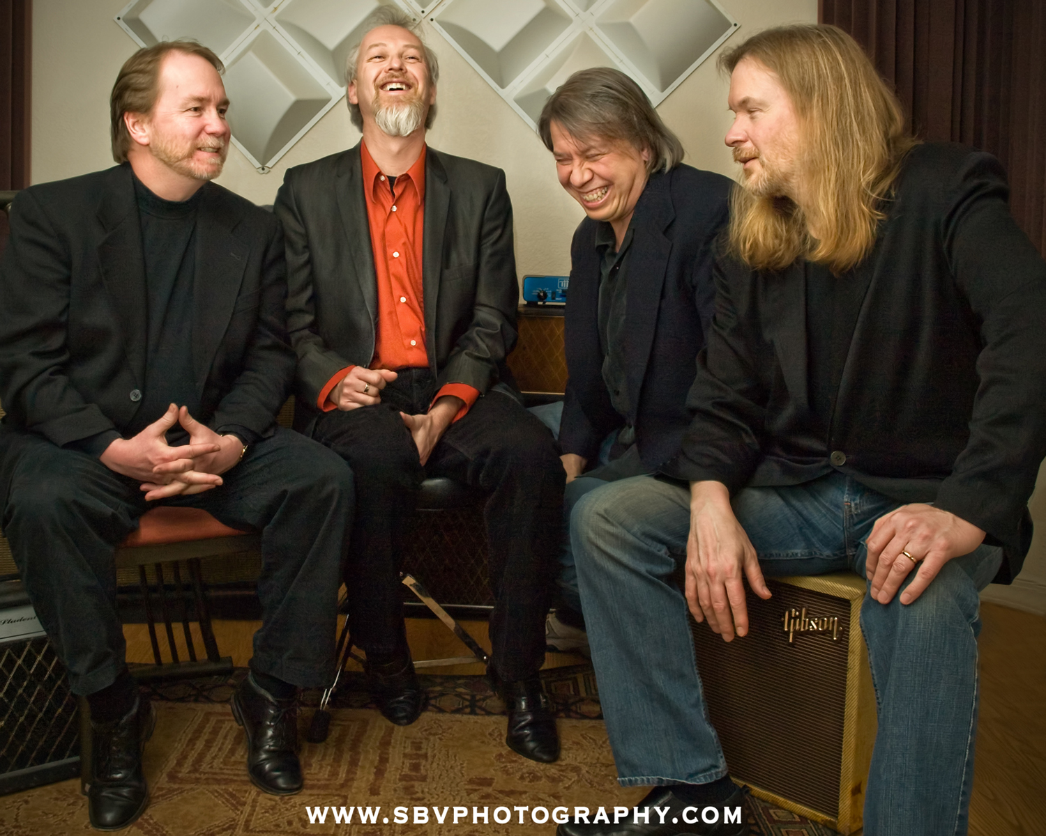 Northwest Indiana rock band Nomad Planets jokes around at an Hammond music studio for their publicity photo session.