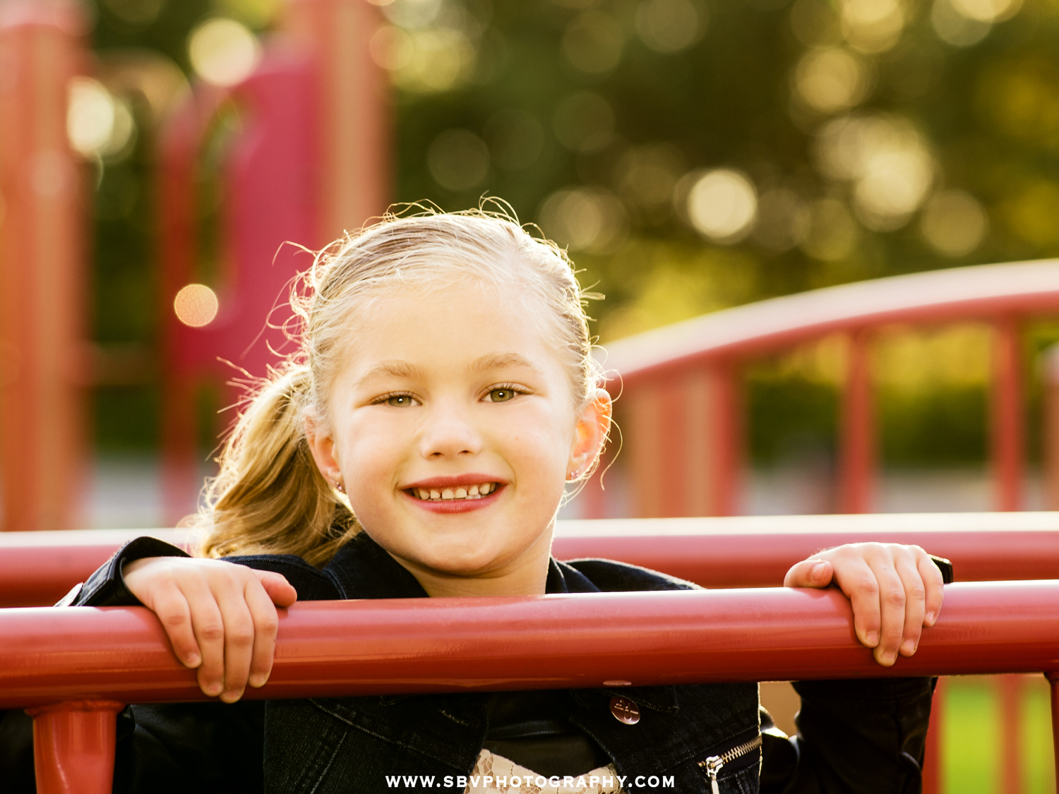 Little girl smiles as she plays in a Northwest Indiana playground for Fall Lifestyle Portraits.