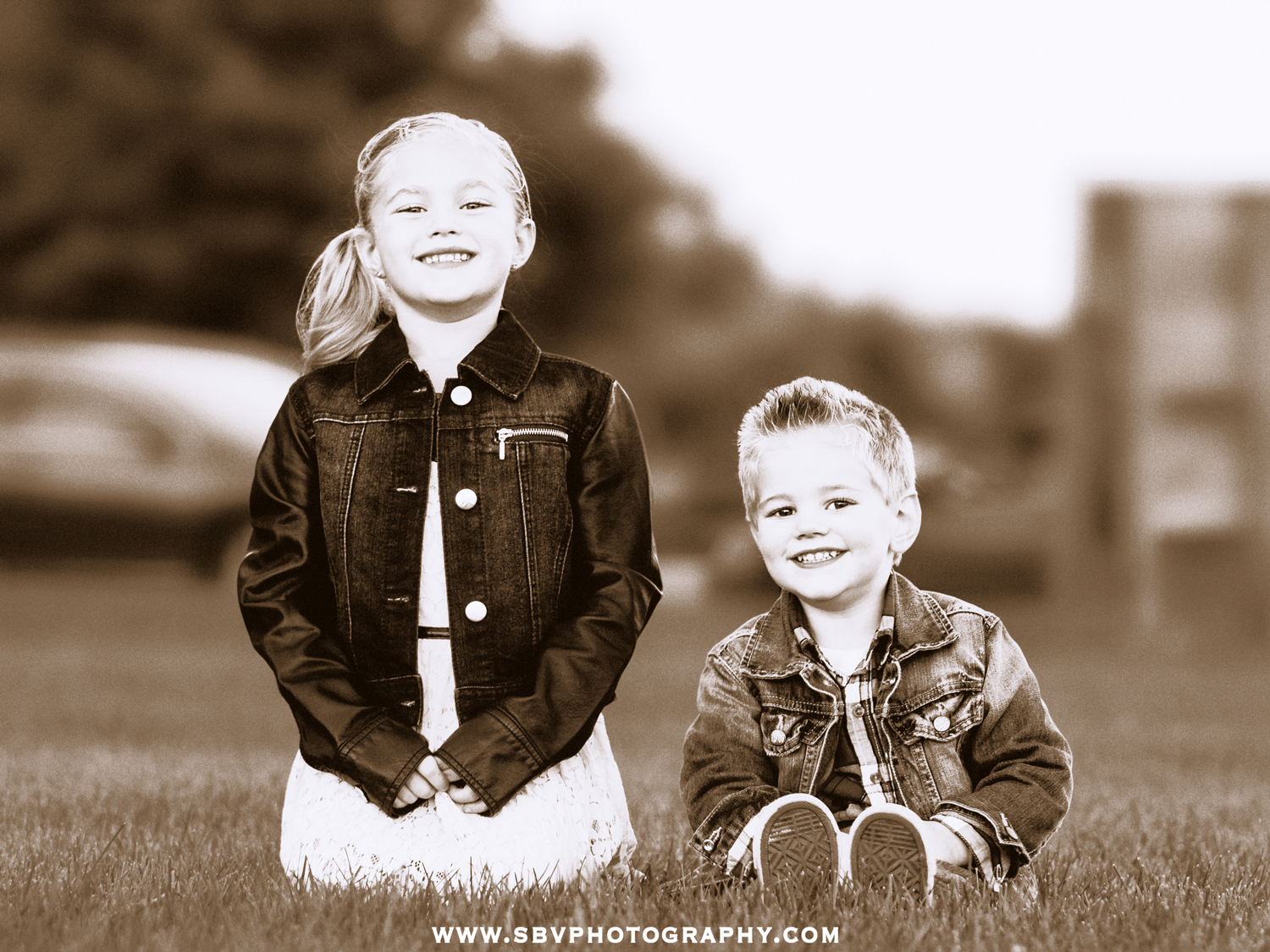 A sepia toned children's portrait of a brother and sister at a Northwest Indiana park during the Fall season.