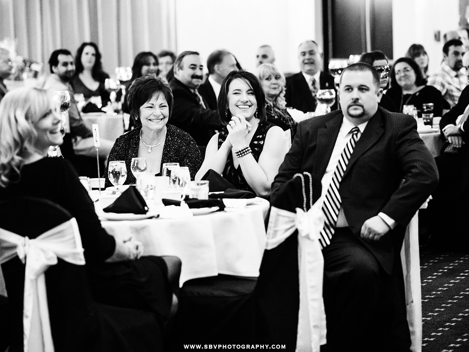 Guests smile and applaud the inspiring speeches after dinner at the NICK foundation benefit.