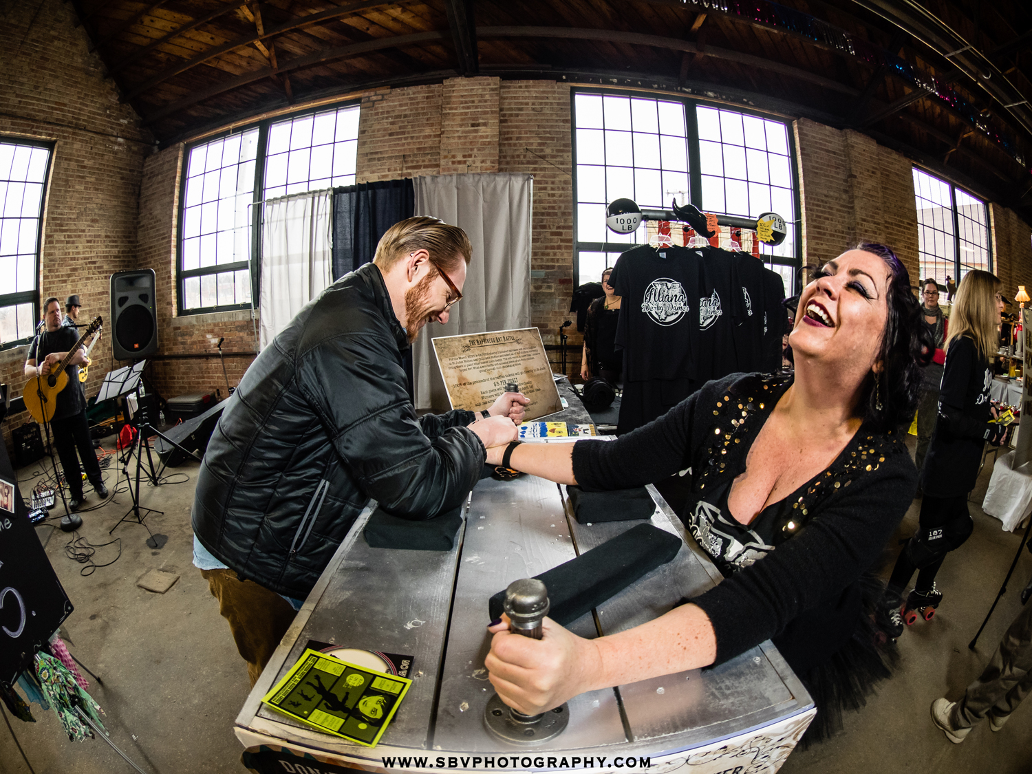 Roller derby girls arm wrestle for charity.