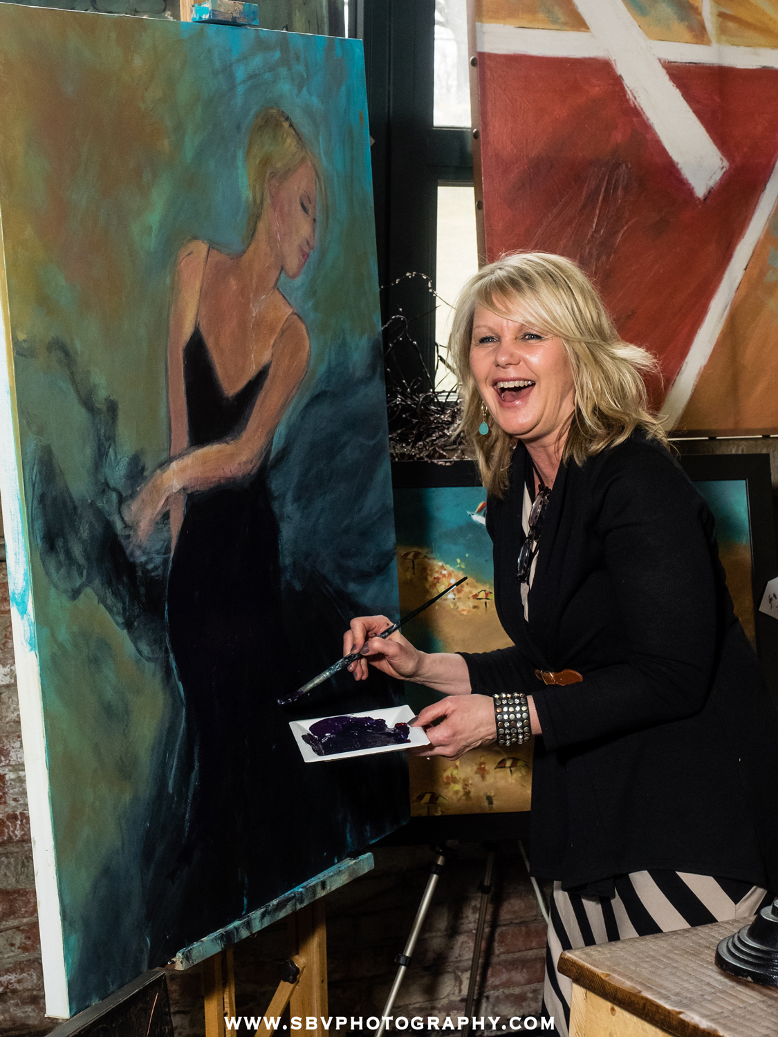 A live painter shares a laugh at the Hunt and Gather event in Crown Point.