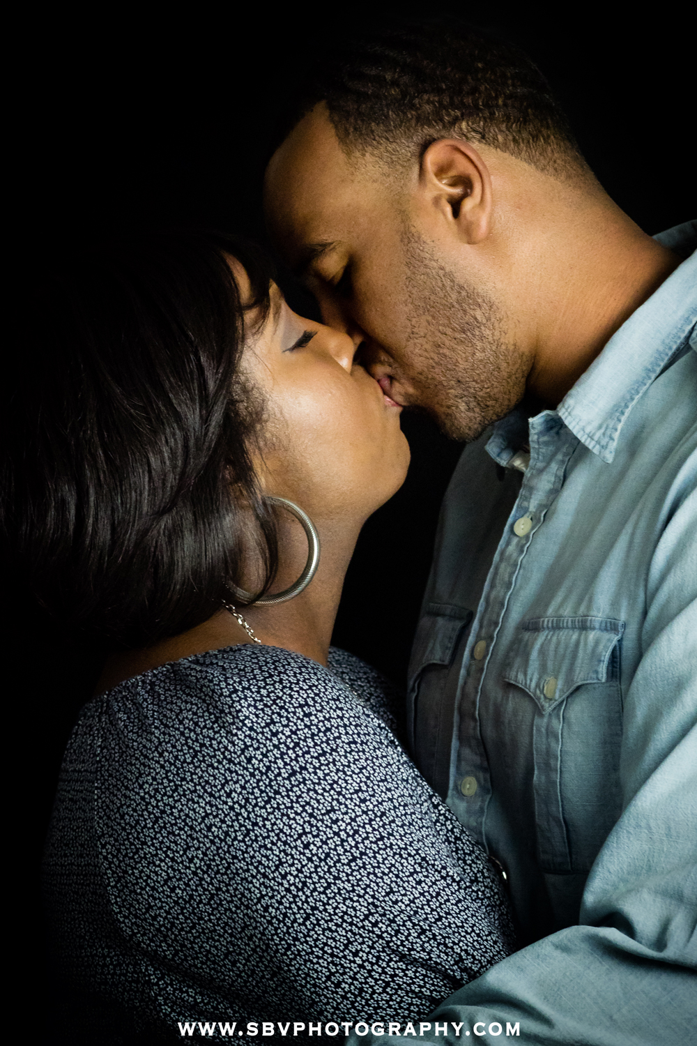 Romantic kiss during a studio portrait session in Crown Point, Indiana.